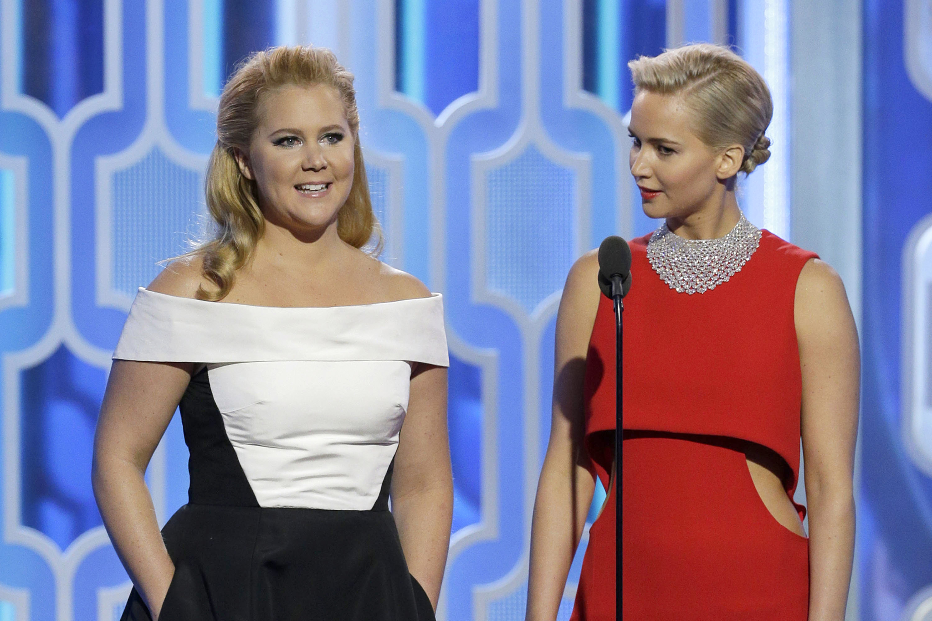 In this handout photo provided by NBCUniversal,  Presenters Amy Schumer and Jennifer Lawrence speak onstage during the 73rd Annual Golden Globe Awards at The Beverly Hilton Hotel on January 10, 2016 in Beverly Hills, California.