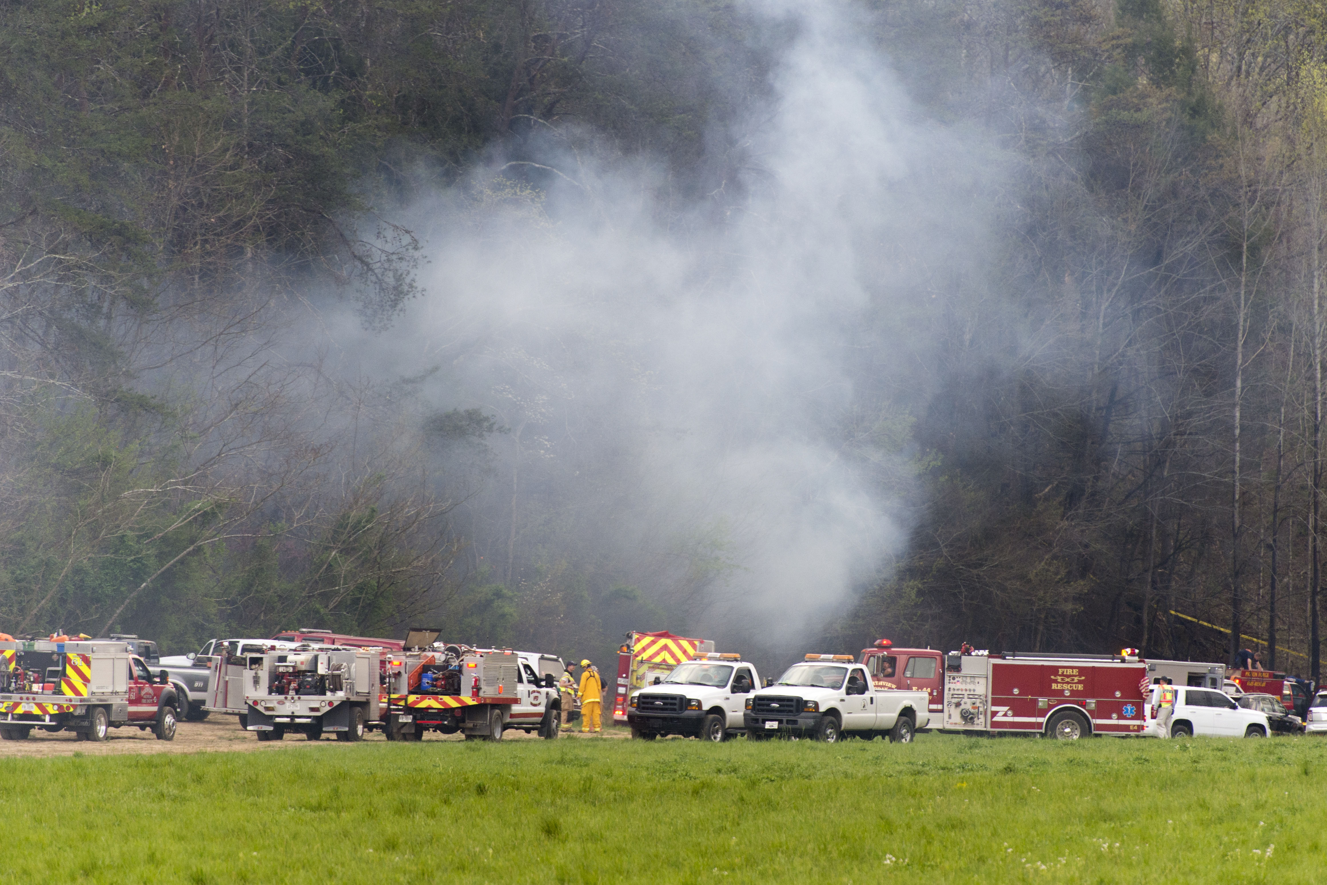 Emergency vehicles respond to the scene of a fatal helicopter crash, April 4, 2016, in Pigeon Forge, Tenn.