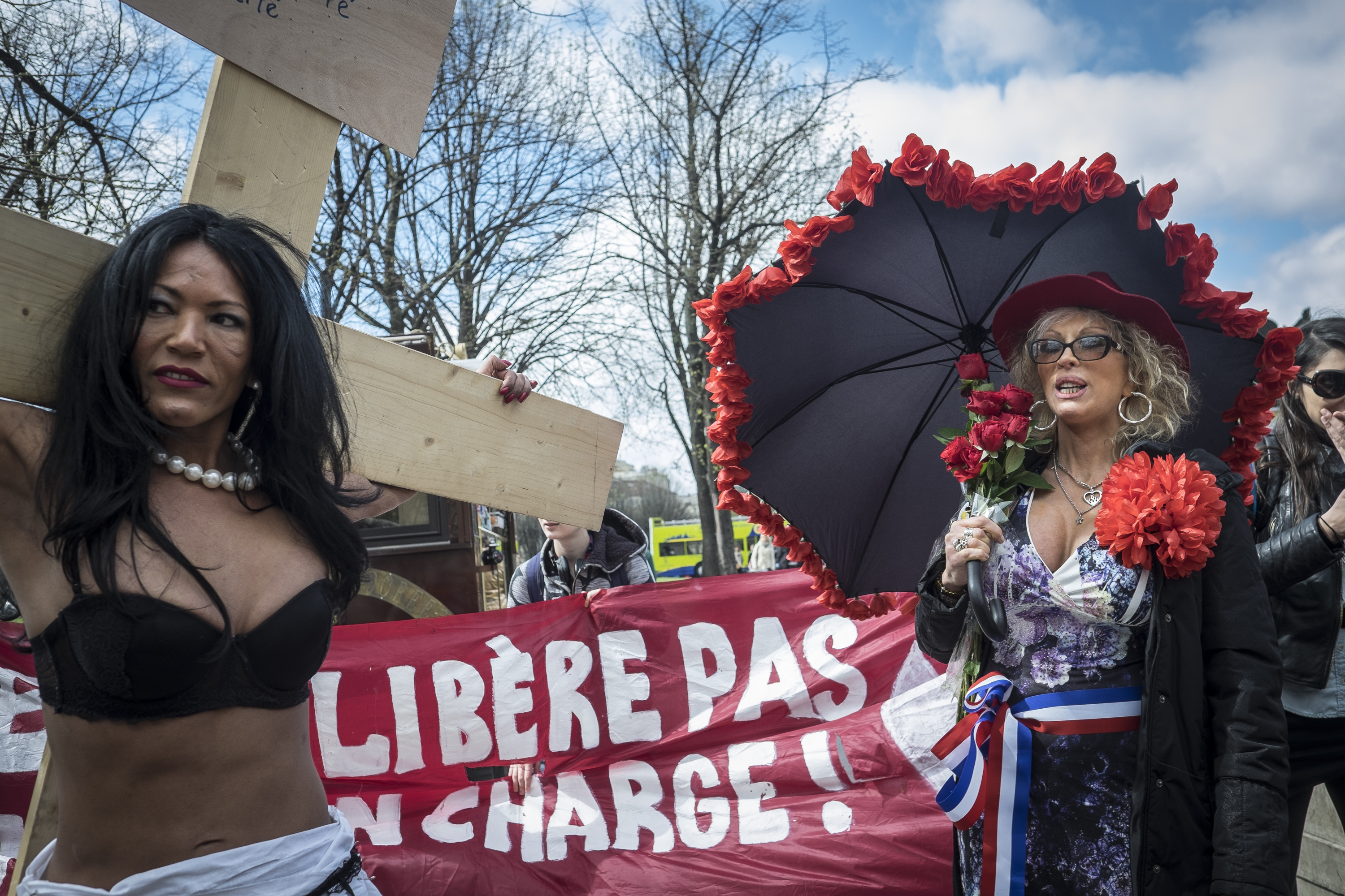 Sex workers and supporters protest near the French National Assembly in Paris on April 6, 2016, as French lawmakers take part in a final debate on a bill that would make it illegal to pay for sex