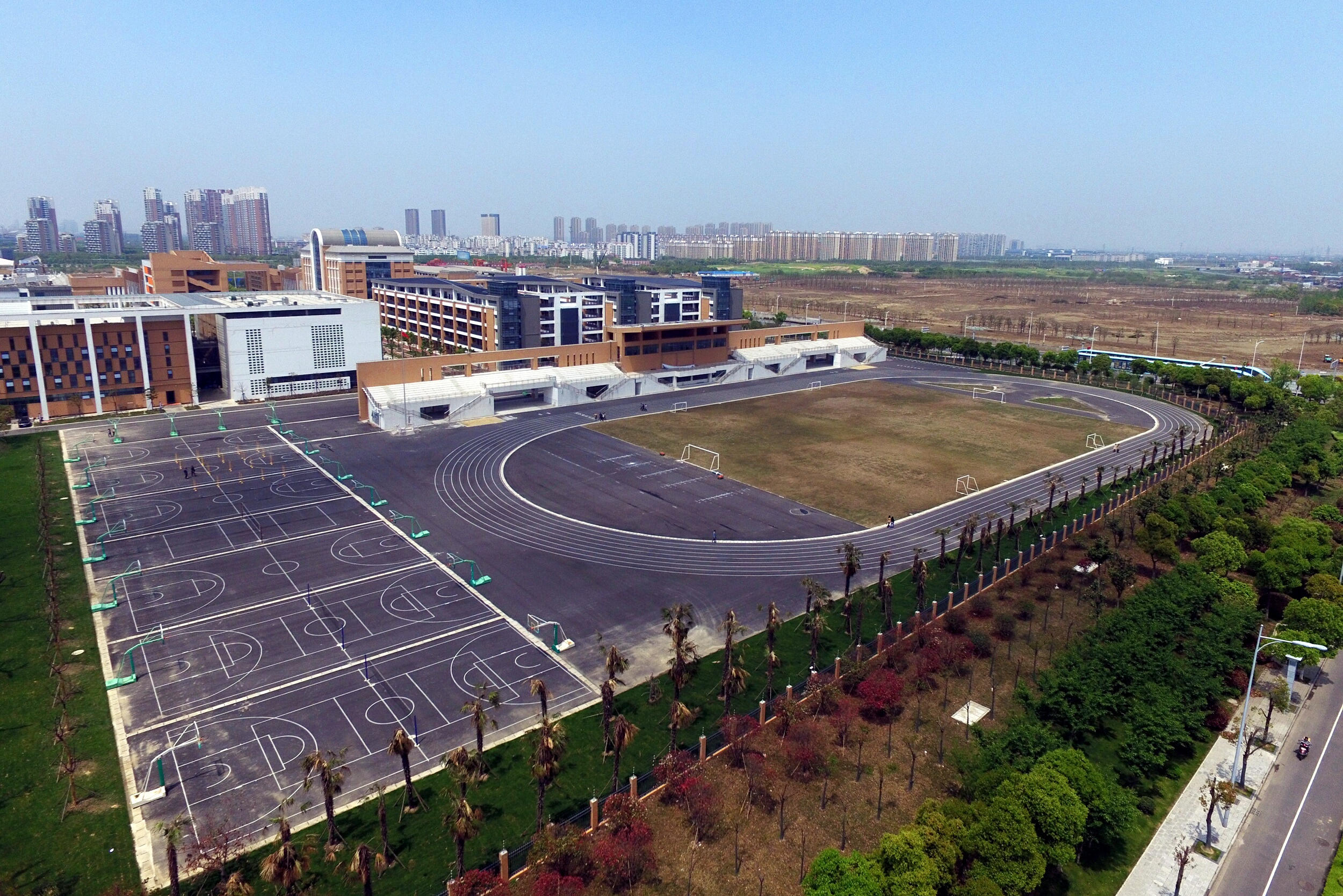 A view of the new campus of Changzhou Foreign Languages School near a toxic site in Changzhou city, China's Jiangsu province, on April 18, 2016