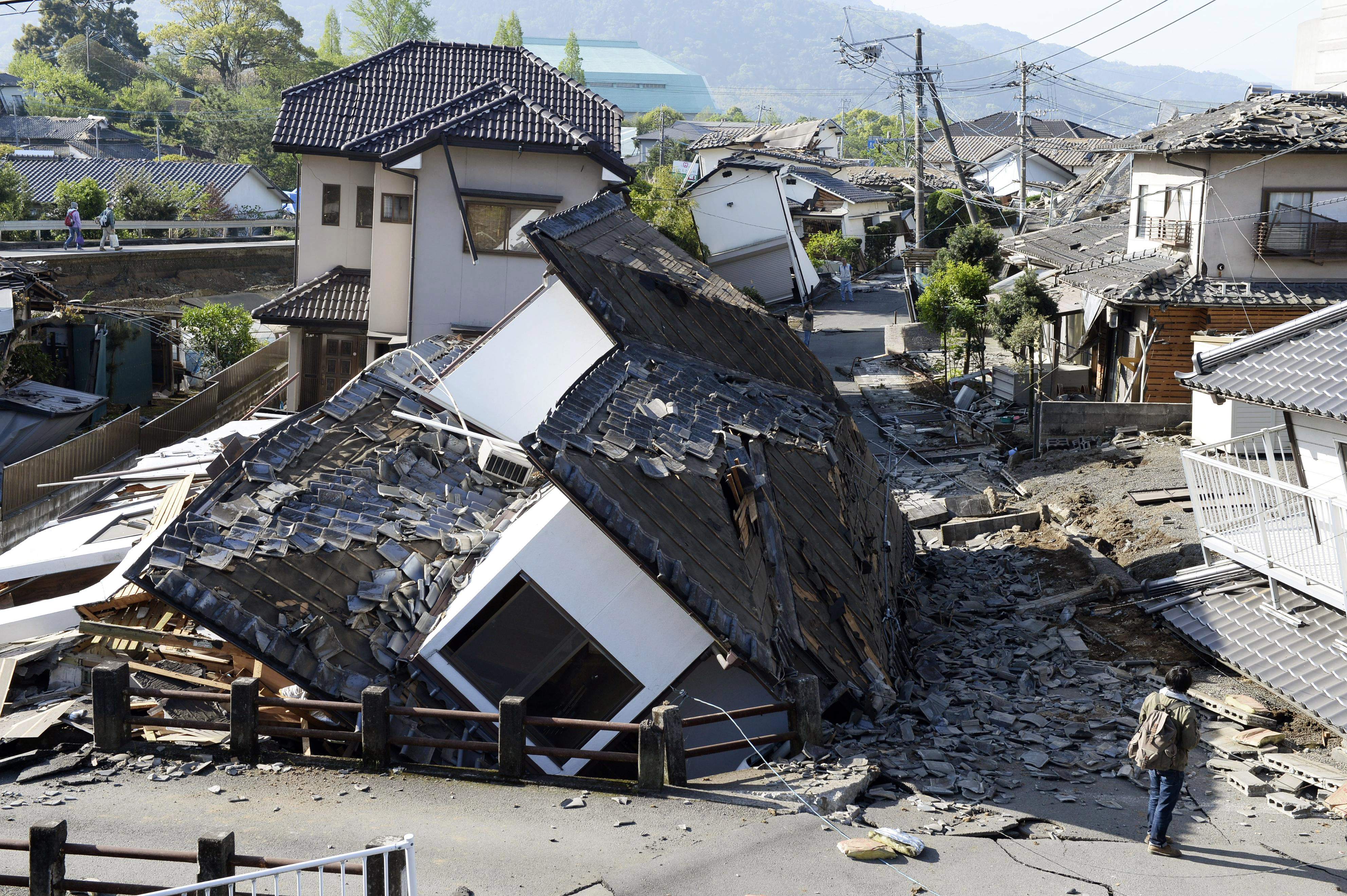 Houses are seen destroyed after an earthquake in Mashiki, Kumamoto prefecture, on April 16, 2016.