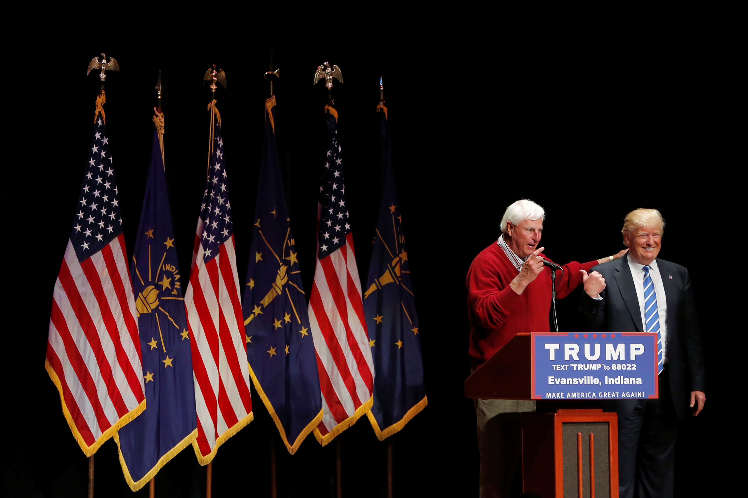 Republican presidential candidate Donald Trump is joined on stage by former Indiana University basketball coach Bob Knight at a campaign event at the Old National Events Plaza in Evansville, Indiana, on April 28, 2016.
