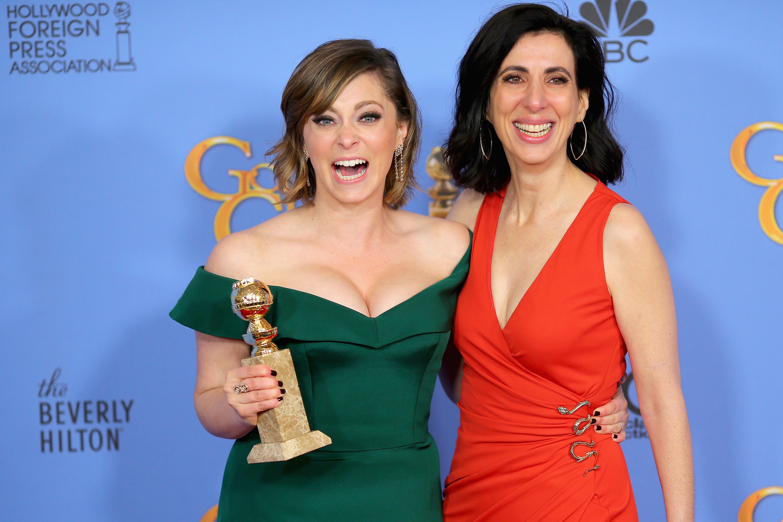 Actress Rachel Bloom, winner of Best Performance by an Actress in a Television Series - Musical or Comedy (L) and screenwriter Aline Brosh McKenna, pose in the press room during the 73rd Annual Golden Globe Awards held at the Beverly Hilton Hotel on January 10, 2016 in Beverly Hills, California.