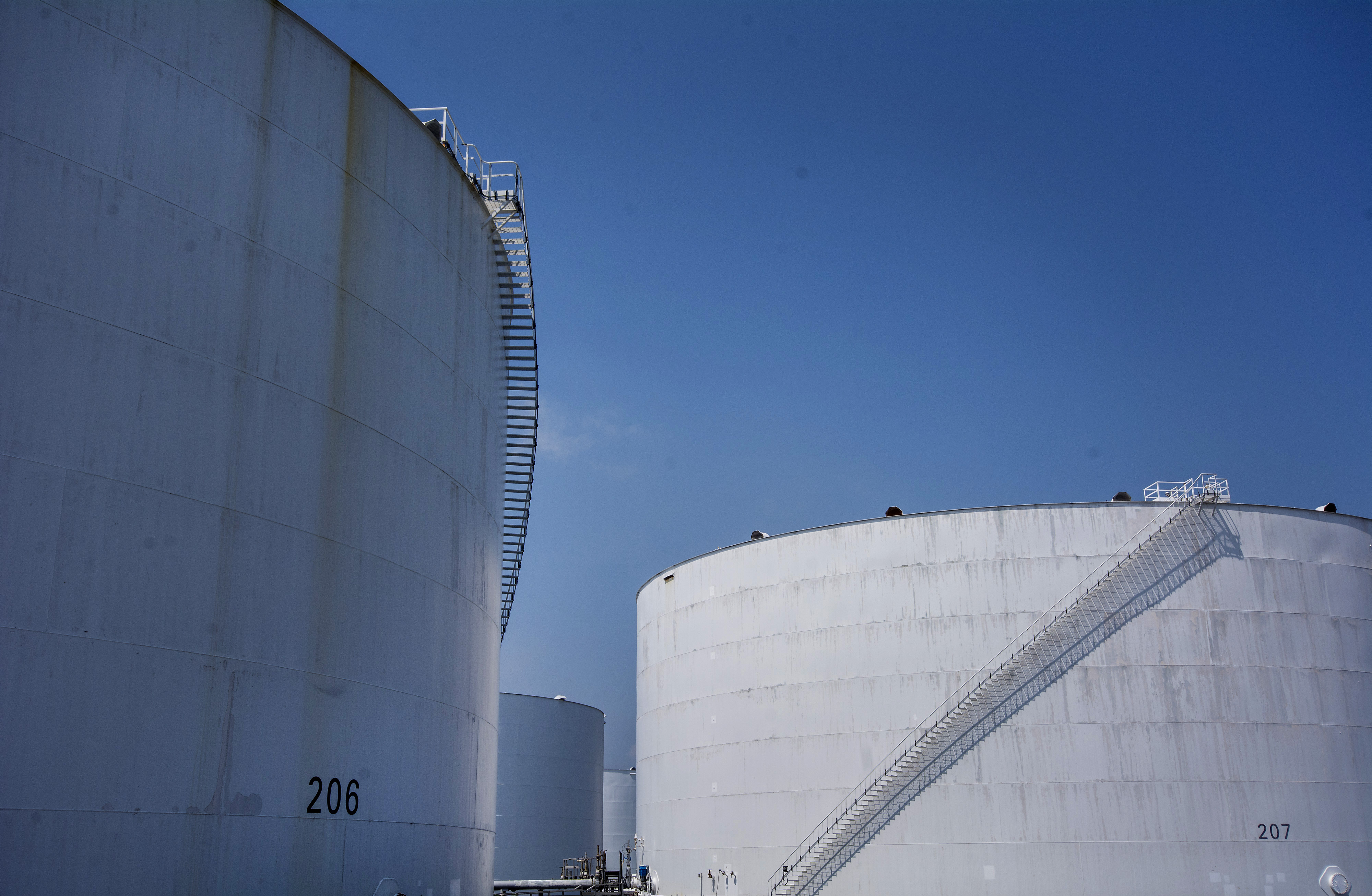 Storage tanks stand at the Irving Oil Ltd. refinery in Saint John, New Brunswick, Canada, on Tuesday, Aug. 5, 2014.