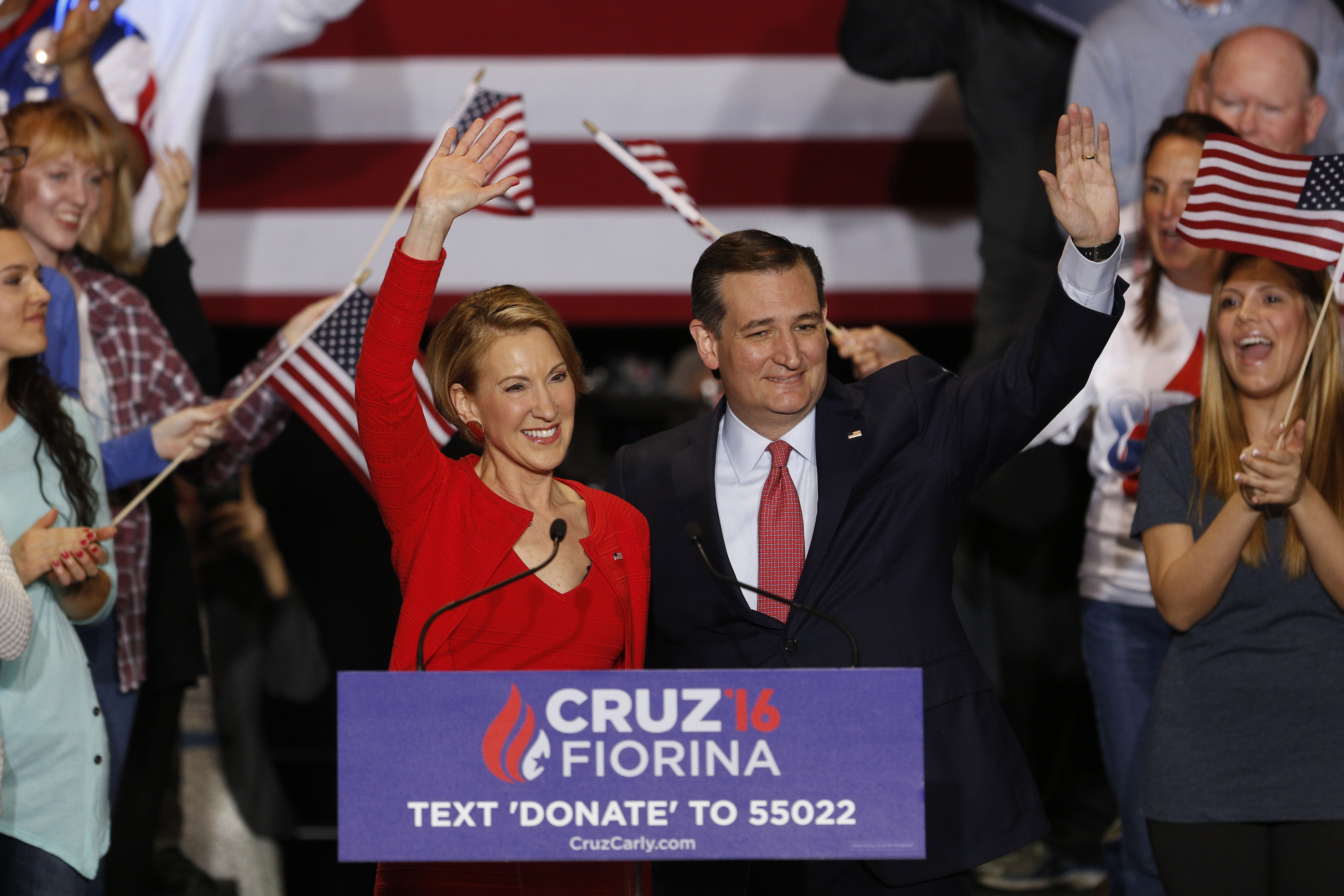 Carly Fiorina, former chairman and chief executive officer of Hewlett-Packard, left, and Senator Ted Cruz, a Republican from Texas and 2016 presidential candidate, wave during a campaign rally in Indianapolis on April 27, 2016