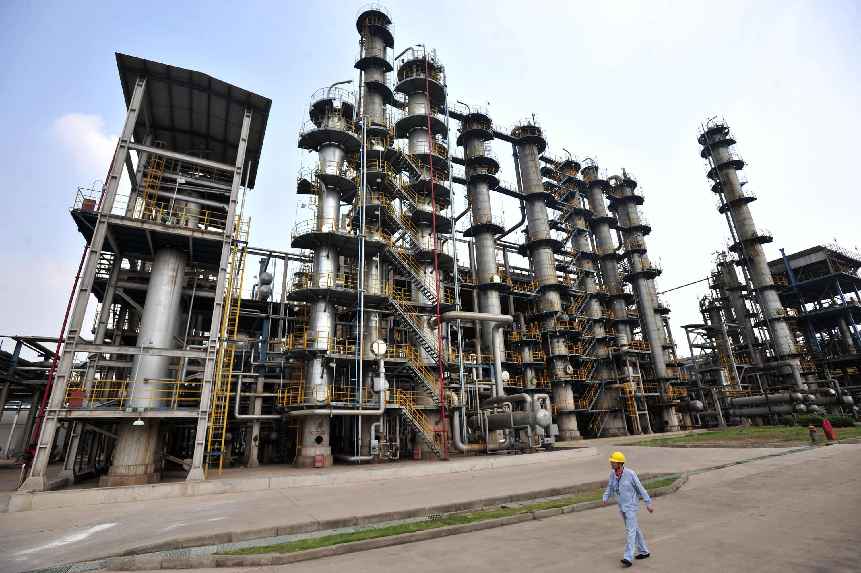 This photo taken on May 10, 2011 shows a worker walking by at an oil refinery of China's Sinopec, in Wuhan, central China's Hubei province.