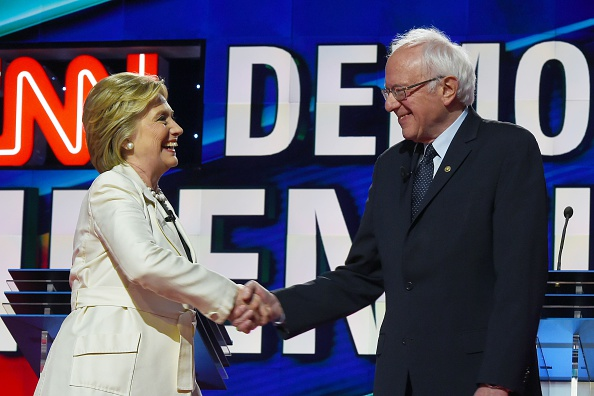 US Democratic presidential candidates Hillary Clinton (L) and Bernie Sanders shake hands before the CNN Democratic Presidential Debate at the Brooklyn Navy Yard on April 14, 2016, in New York.