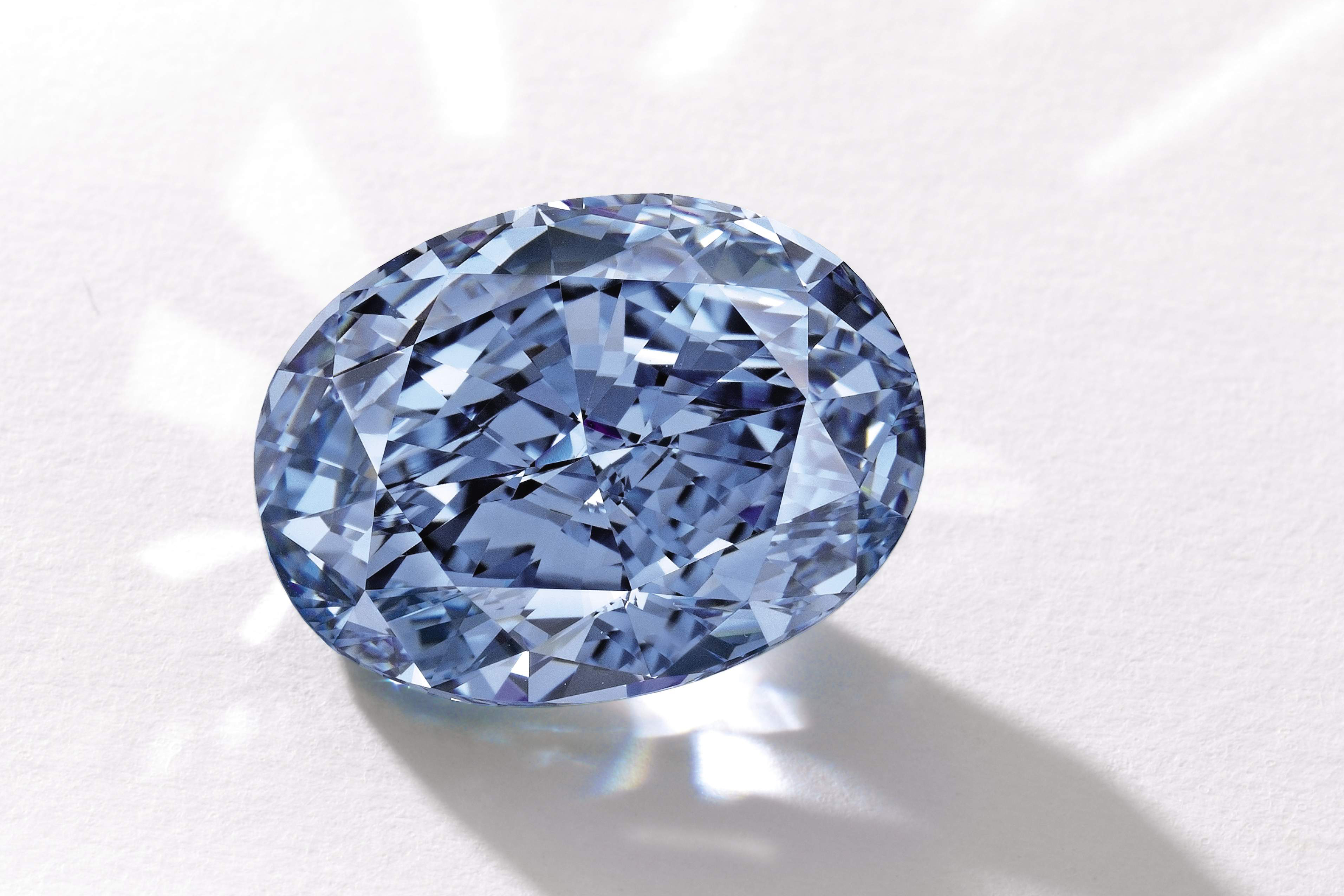 This photo provided by Sotheby's shows a 10.10-carat oval, internally flawless blue diamond. The 'De Beers Millennium Jewel 4' is largest oval fancy vivid blue diamond ever to appear at auction.
