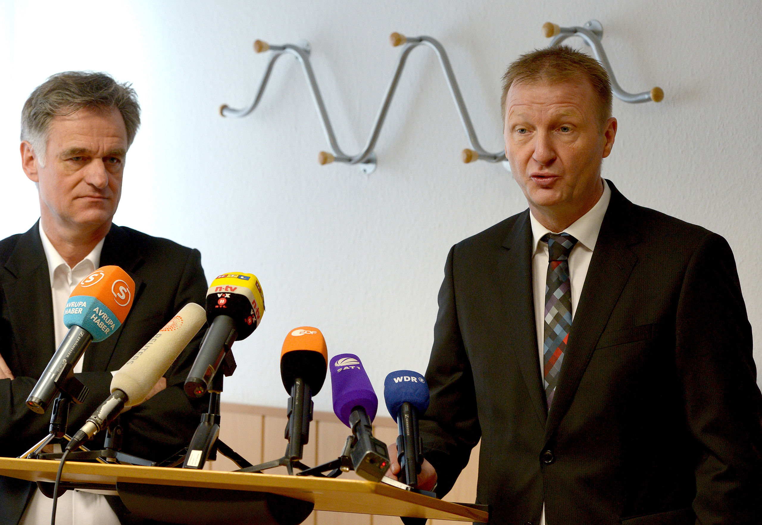 Dirk Sauerborn, left, stands next to North Rhine-Westphalia Interior Minister Ralf Jäger during a news conference on the intervention project Wegweiser, or Signpost, in Dusseldorf, Germany, March 24, 2014.