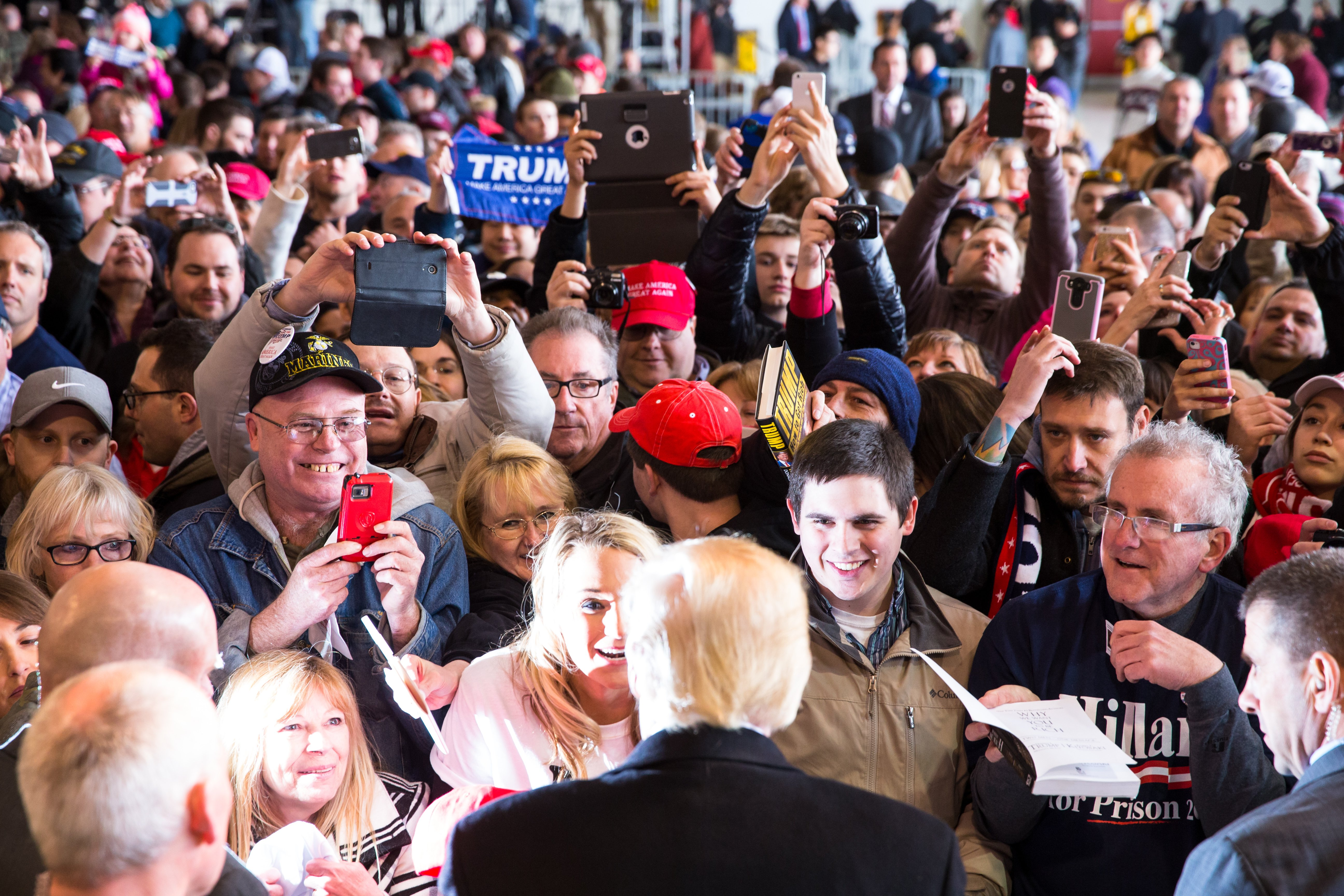 Republican presidential candidate Donald Trump greets the crowd at a rally for his campaign in Rochester, New York on April 10, 2016.