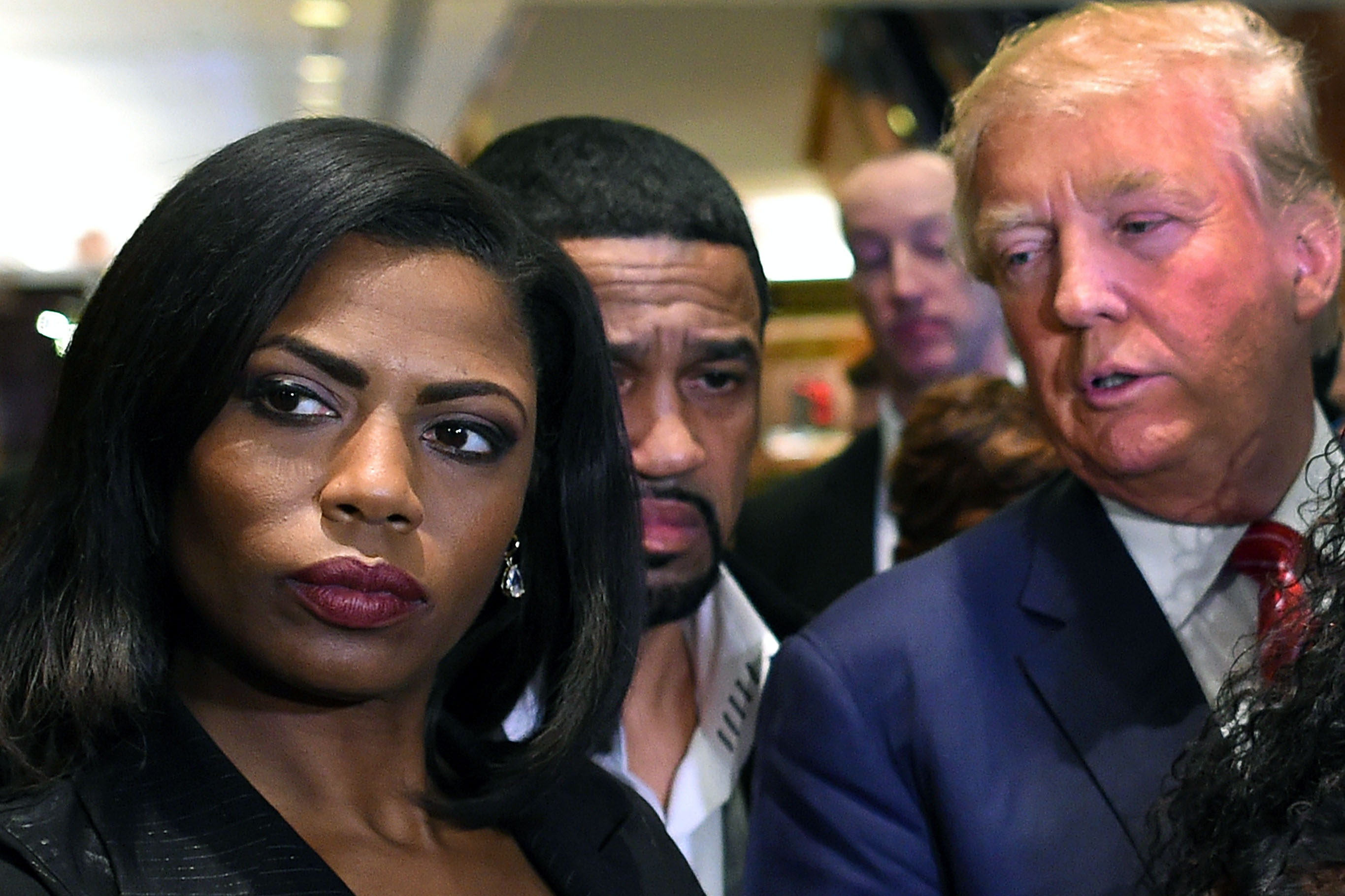Omarosa Manigault, left, who was a contestant on the first season of Donald Trump's  The Apprentice  and is now an ordained minister, appears alongside Republican presidential candidate Donald Trump during a news conference on Nov. 30, 2015.