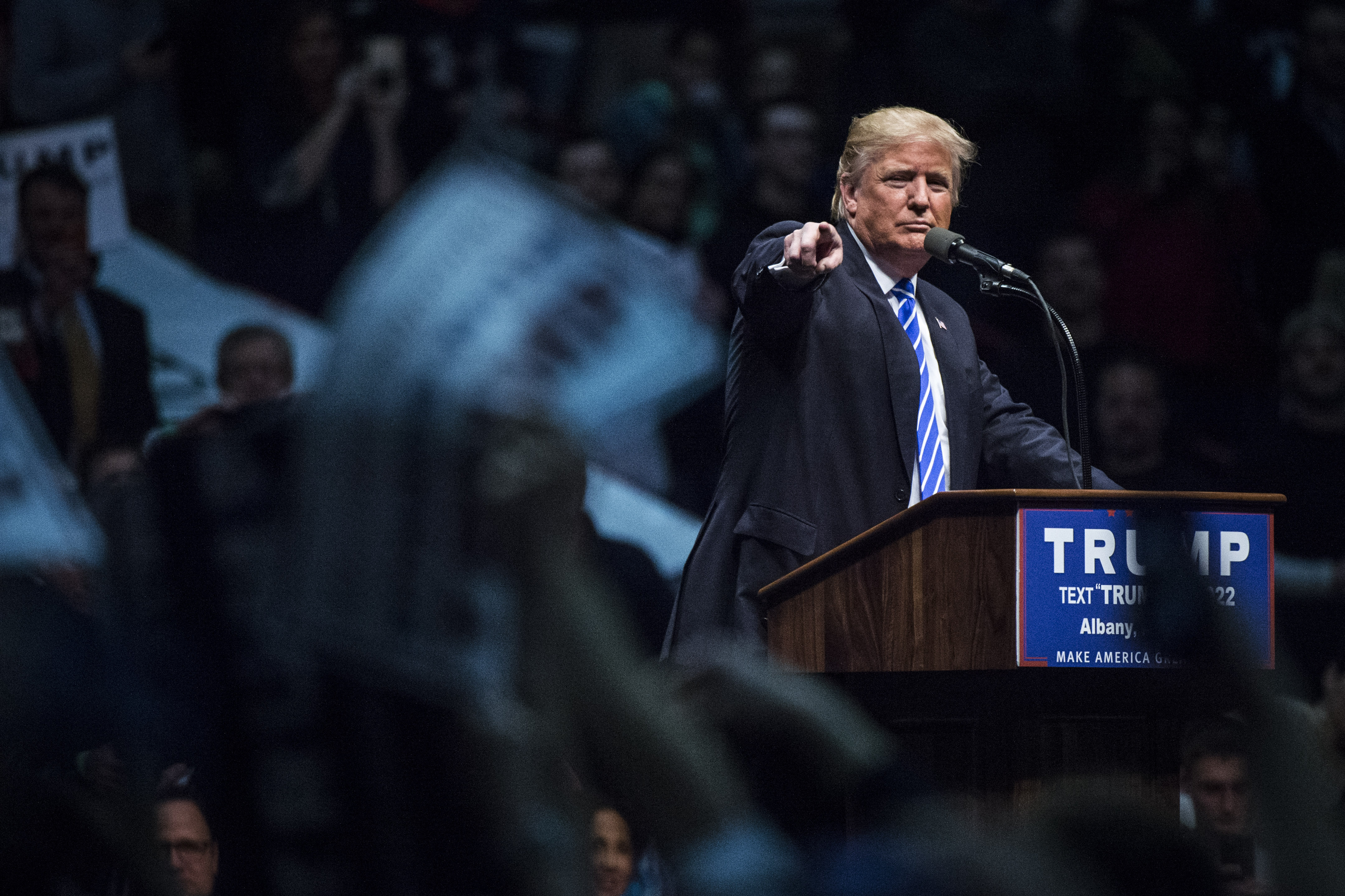 Republican presidential candidate Donald Trump points to a protestor as he speaks during a campaign event at the Times Union Center in Albany, N.Y. on April 11.