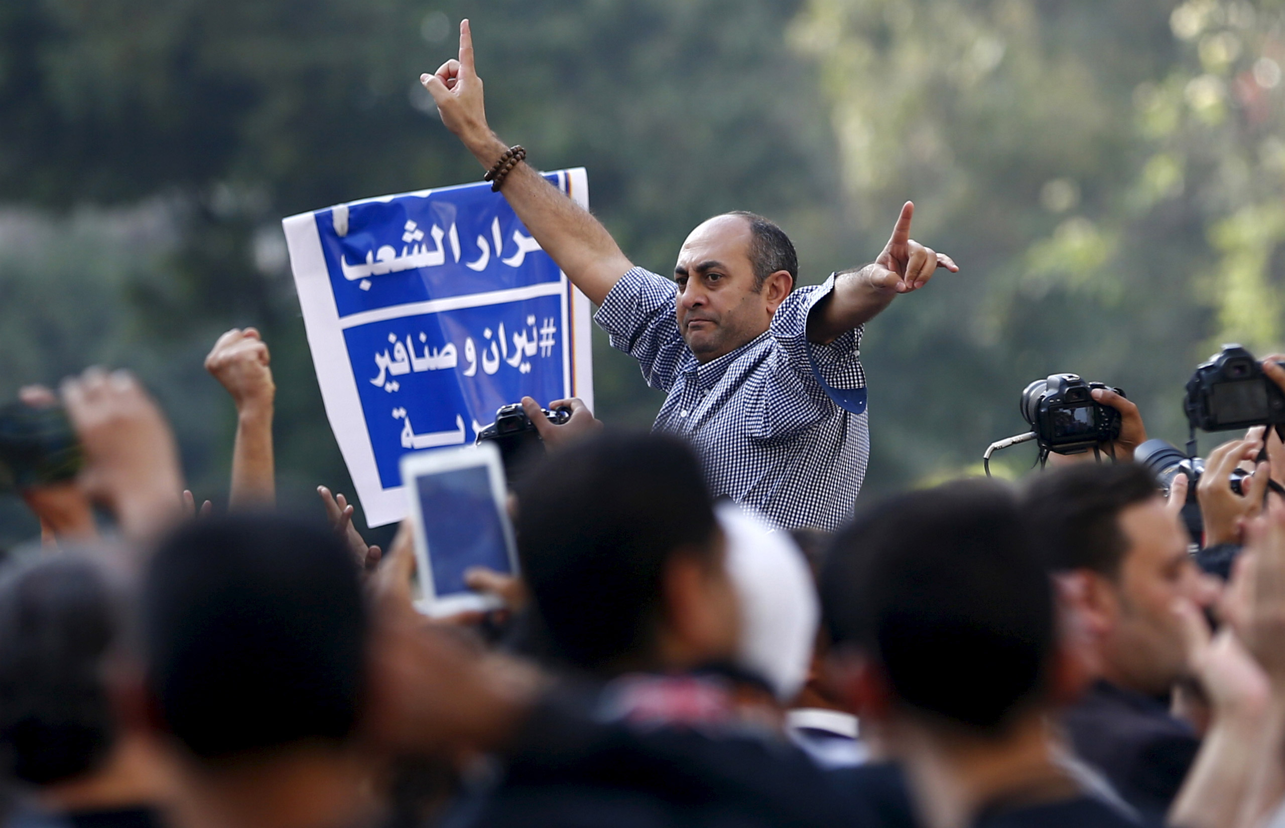 A former presidential candidate and lawyer Khaled Ali shouts slogans against President Abdel Fattah al-Sisi and the government during a demonstration in Cairo on April 15, 2016.