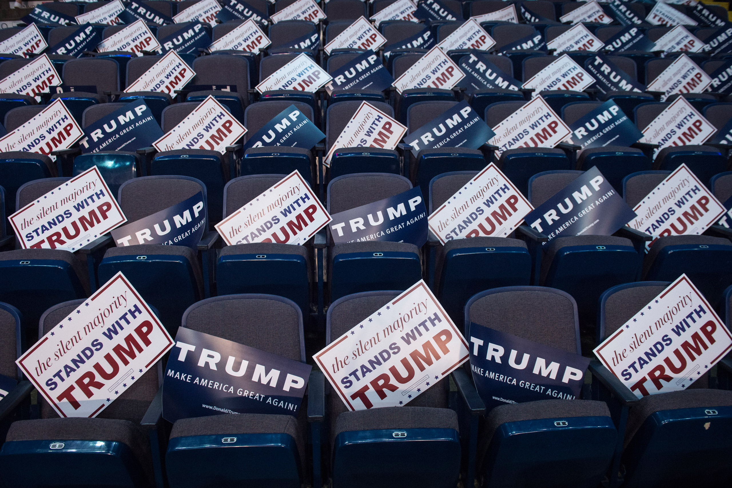 Signs are seen in empty seats before republican presidential candidate Donald Trump speaks during a campaign event at the Times Union Center in Albany, NY on April 11, 2016.
