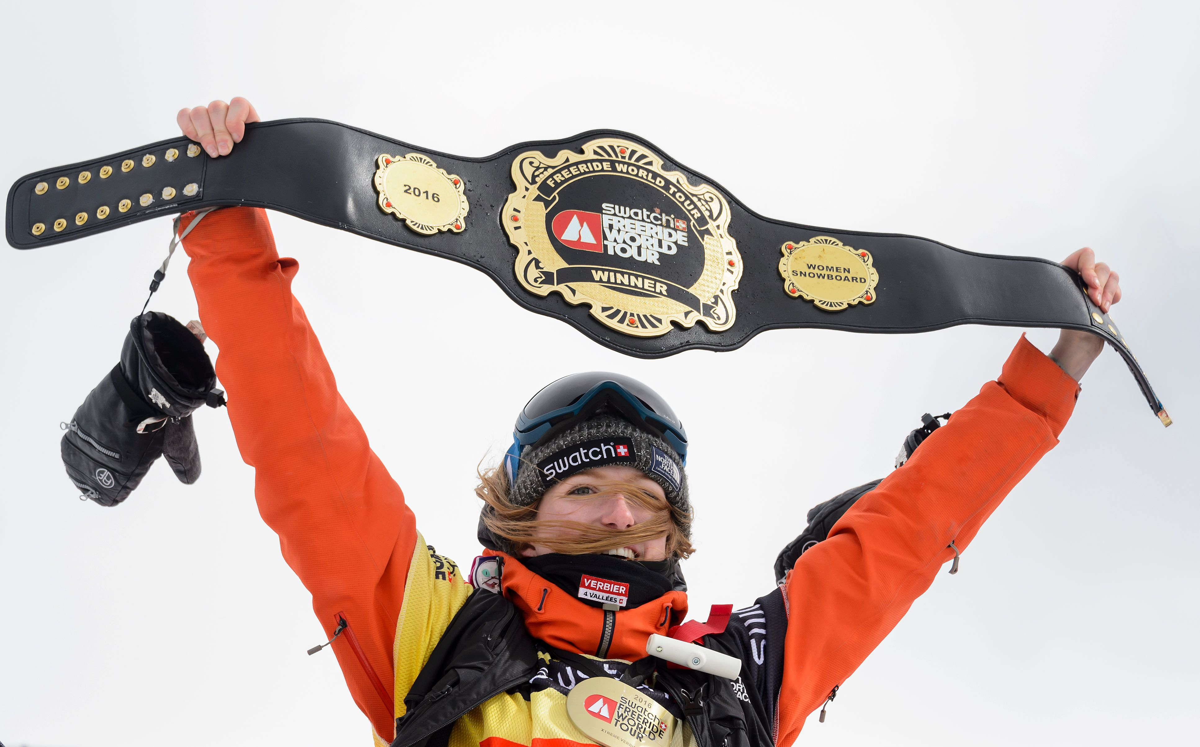 World champion Switzerland's Estelle Balet waves with the overall belt after she won the women's snowboard event at the Bec des Rosses during the Verbier Xtreme Freeride World Tour final on April 2, 2016 above the Swiss Alps resort of Verbier.