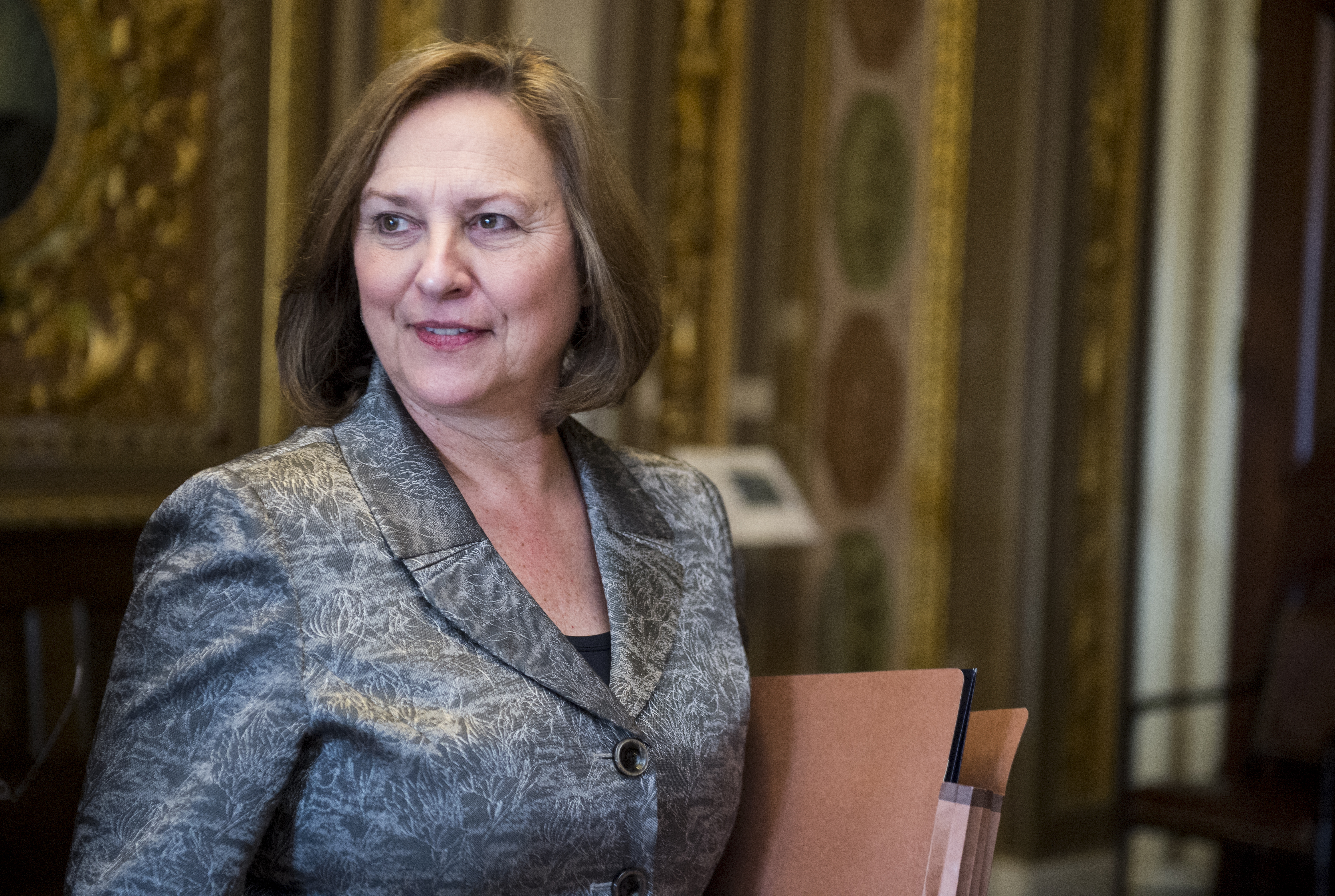 Sen. Deb Fischer, R-Neb., leaves the Senate Republicans' policy lunch on April 1, 2014.