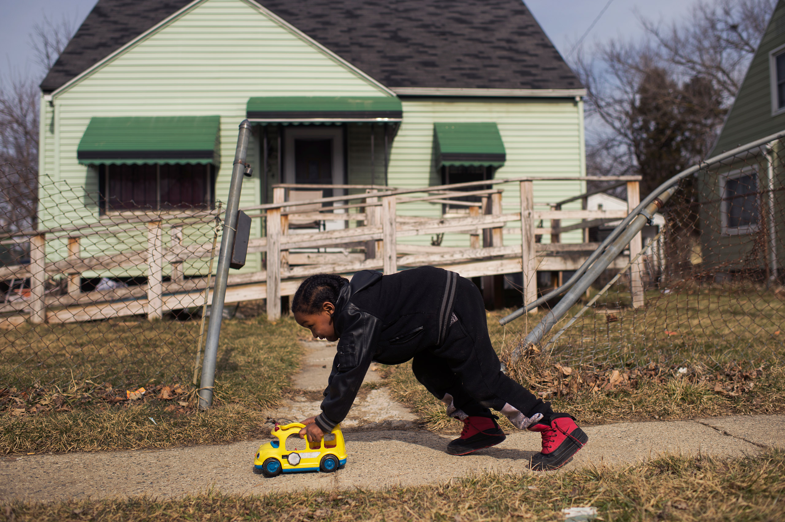 Davarious Griffin, 5, who has had elevated levels of lead detected in his blood, plays outside of his house on Ridgeway Avenue in Flint, Mich., on Feb. 23, 2016.