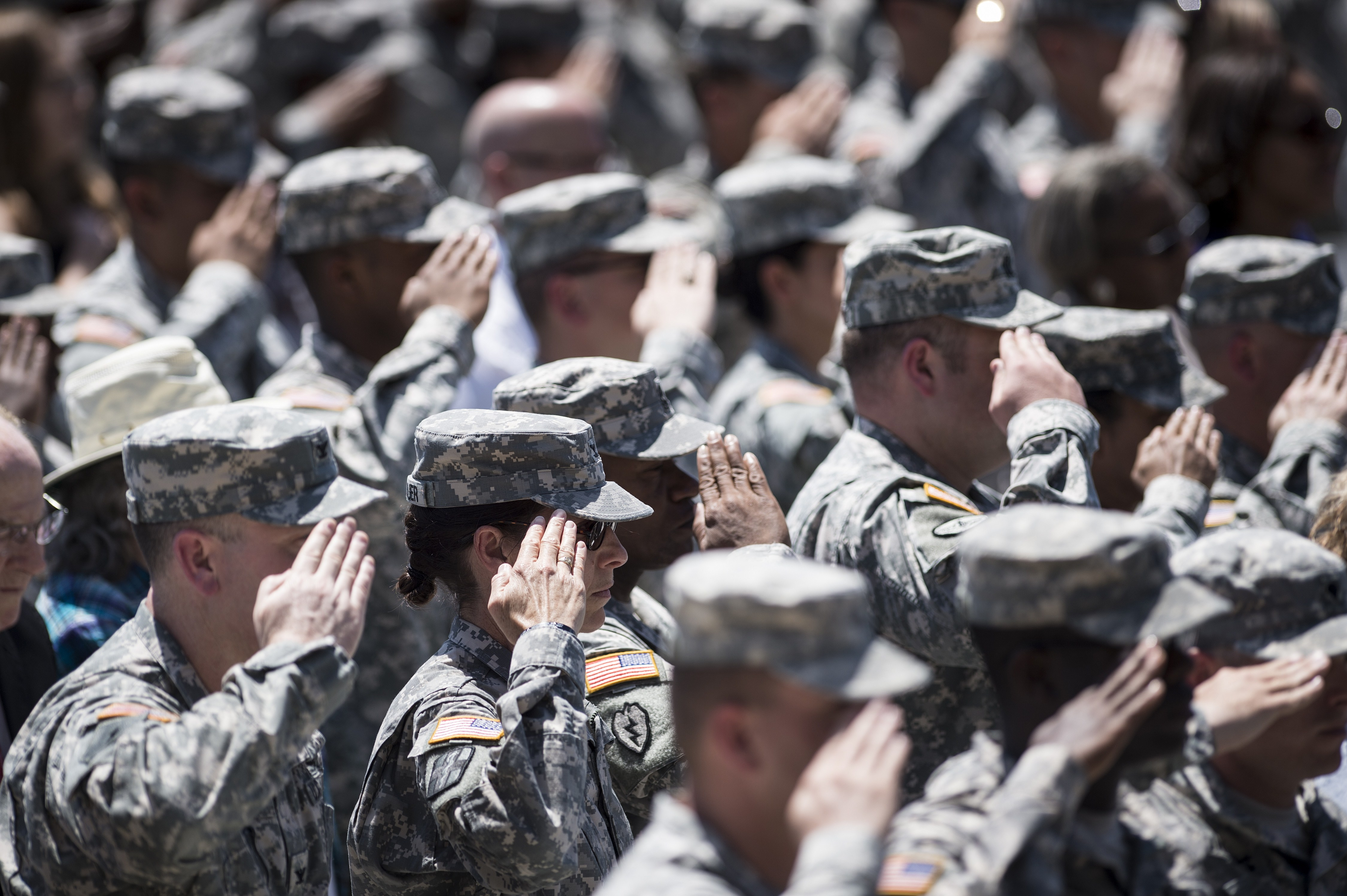 Soldiers listen to the US national anthem during a memorial service at Fort Hood in Texas on April 9, 2014.