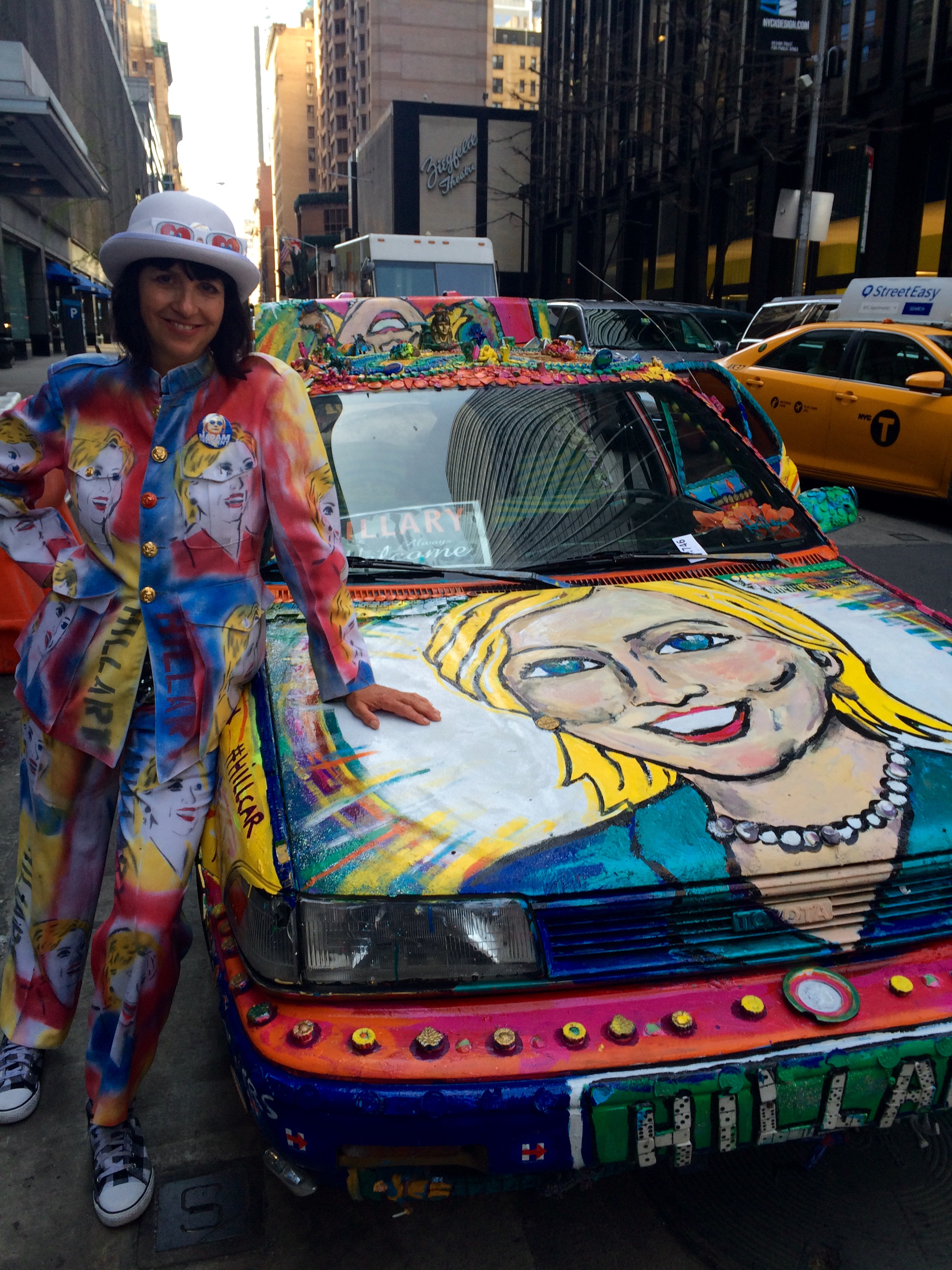 Gretchen Baer in her Hillary Clinton pantsuit, next to her Hillary Clinton car