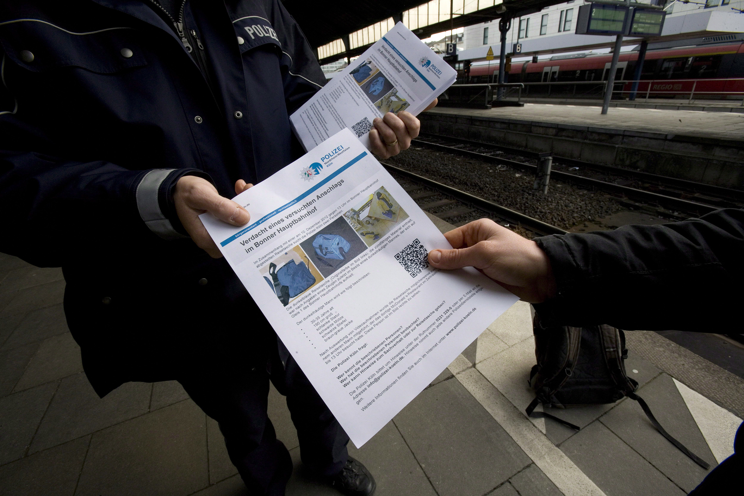 A poster released by the police shows the suspect of an attempted bomb attack at the central train station in Bonn, Germany, Dec. 13, 2012.