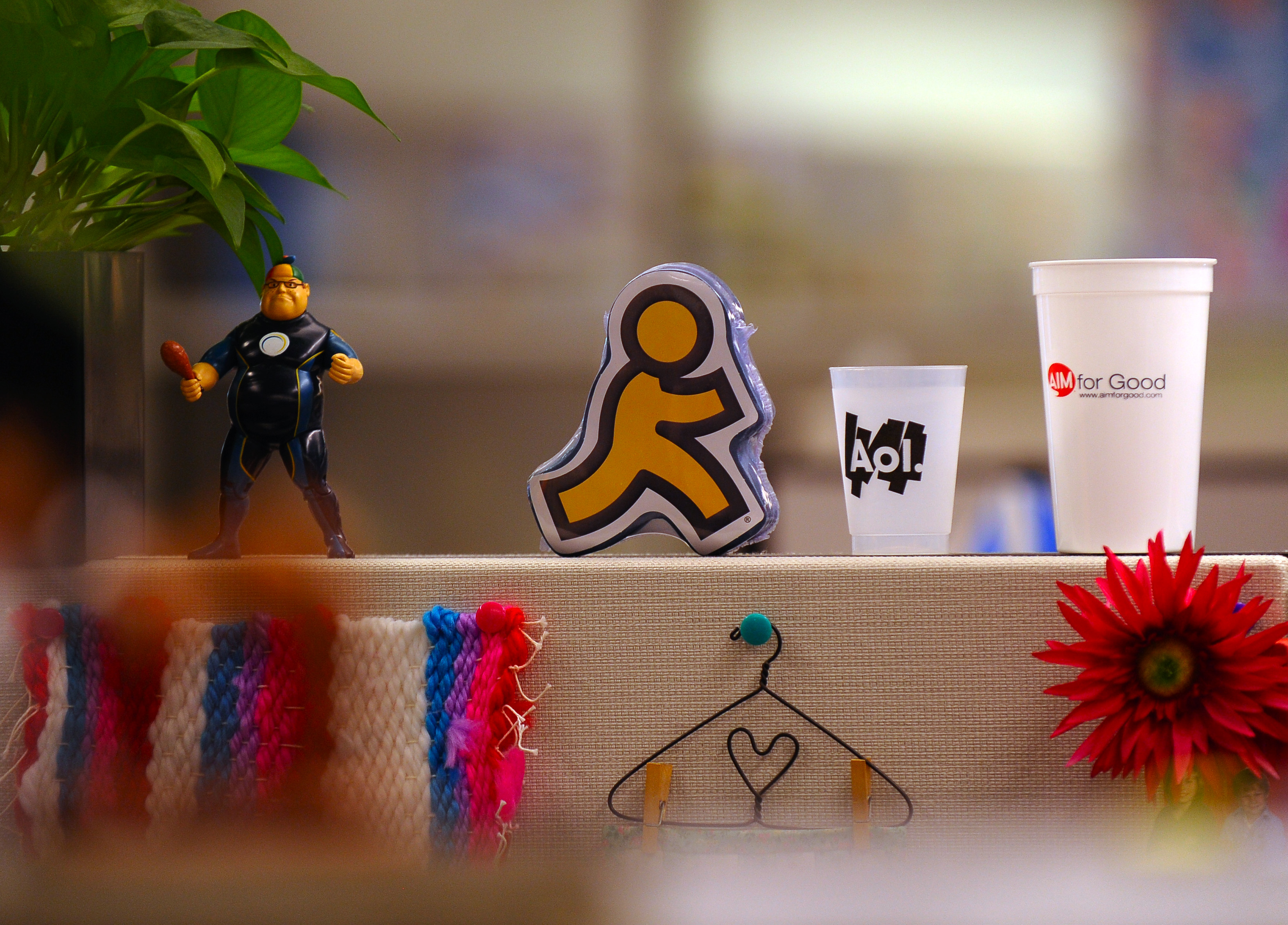 The original AOL logo figurine is displayed at an employee's desk at AOL headquarters on May 19, 2010 in Dulles, VA.