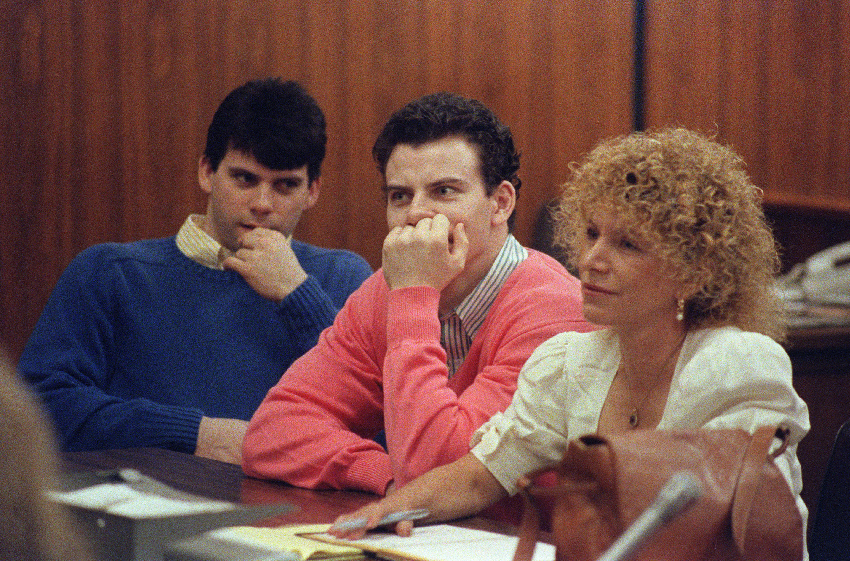 Erik Menendez (C) and his brother Lyle (L) are pictured, on Aug. 12, 1991 in Beverly Hills