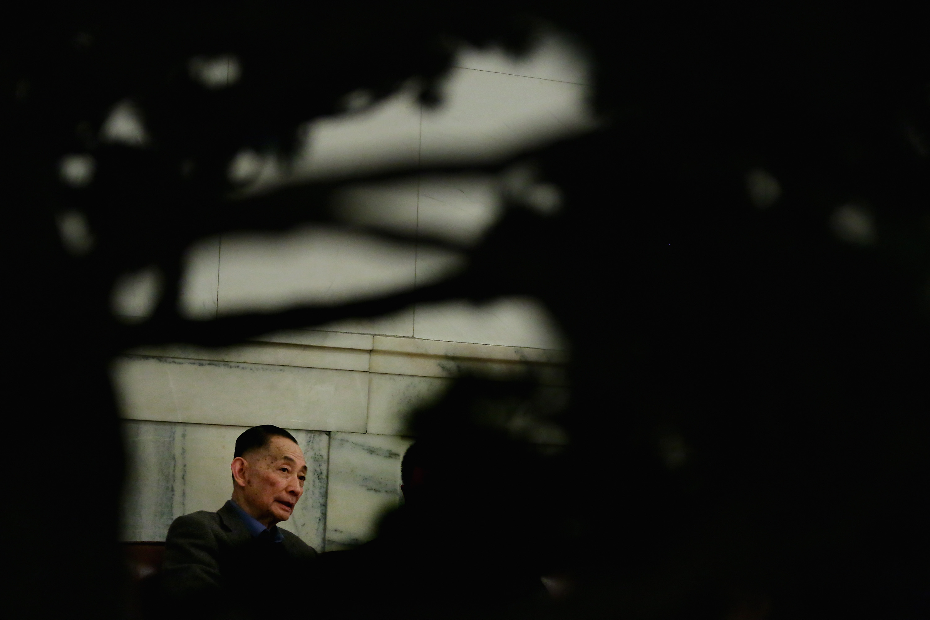 Mei Baojiu, Peking opera master, rests outside the meeting room of the Great Hall of the People during a plenary session of the Chinese People's Political Consultative Conference, at which he is a delegate, on March 7, 2013, in Beijing