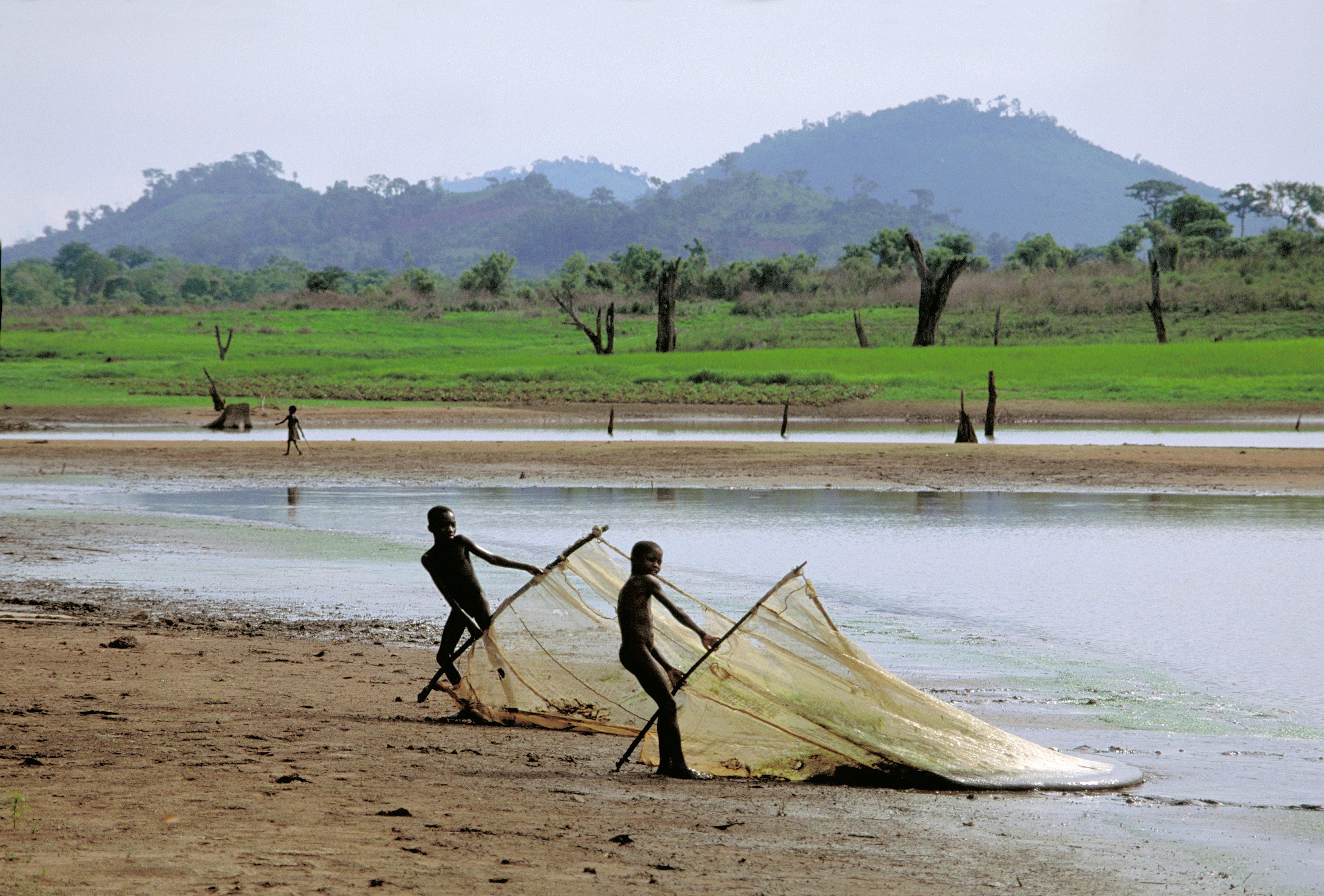 Boys fishing on Lake Volta in Ghana, West Africa.