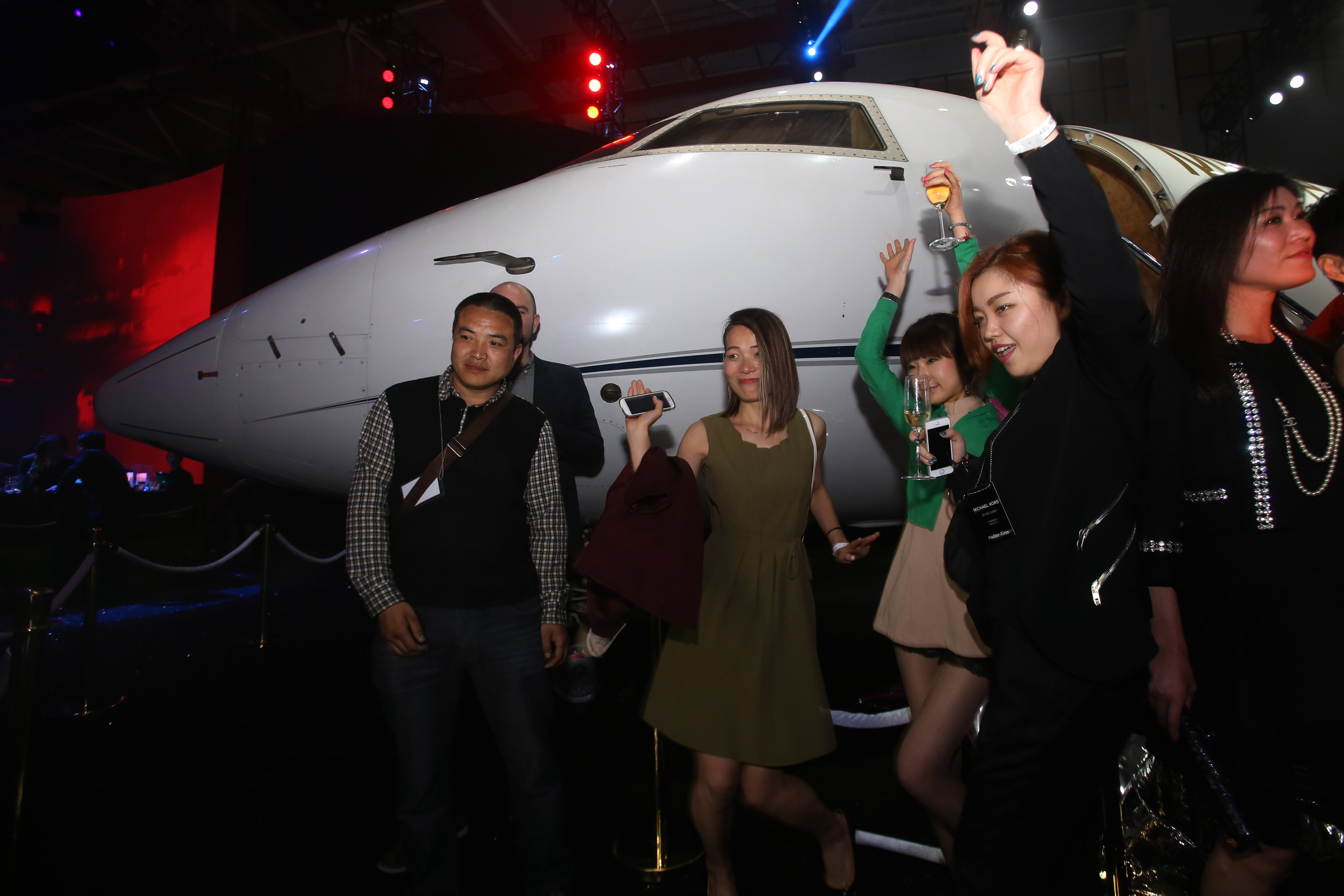 Guests take part in a party after the Michael Kors Jet Set Experience fashion show on May 9, 2014, in Shanghai