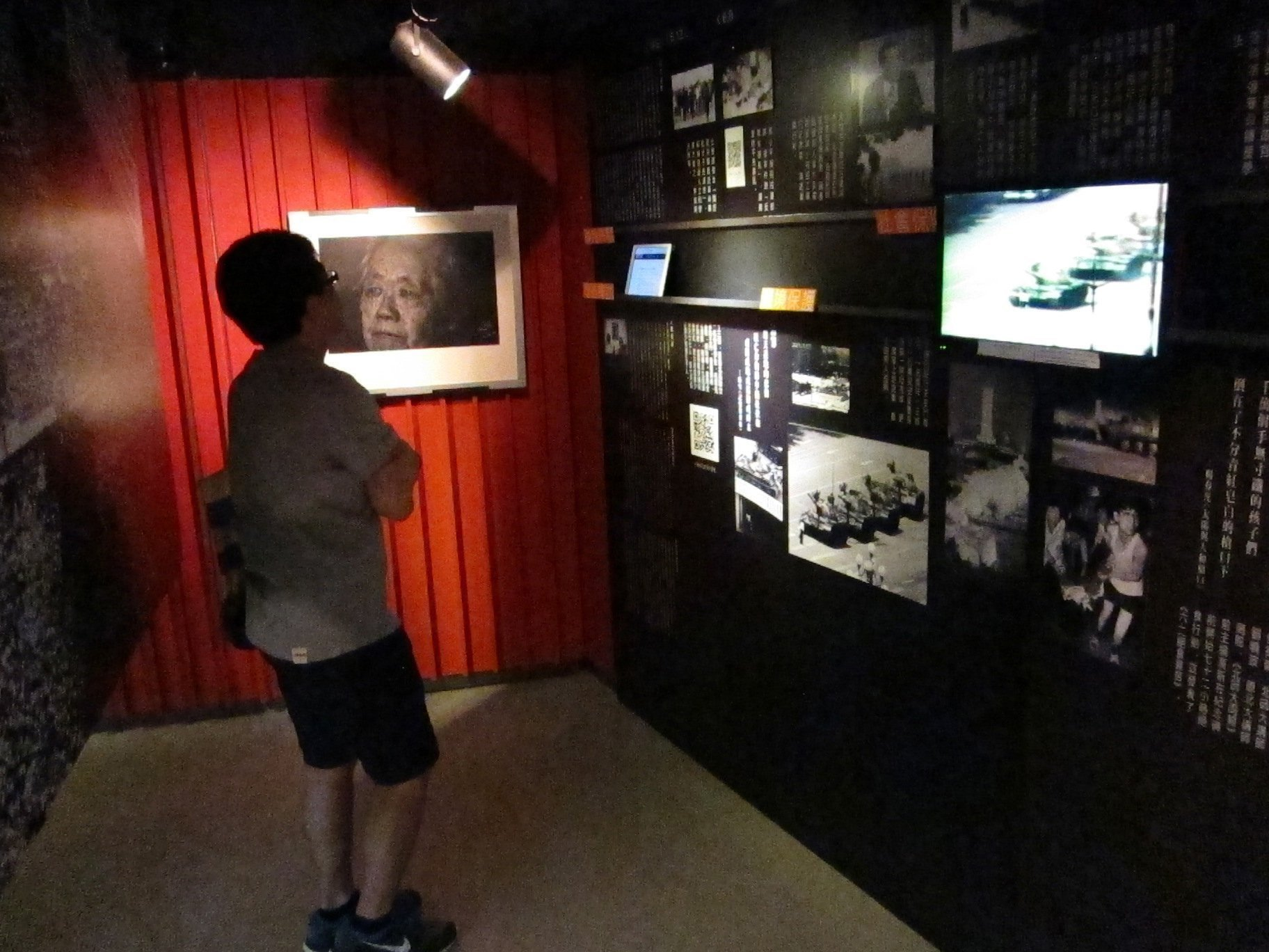 A visitor to the June 4 Memorial Hall in Hong Kong watches a video of Chinese tanks rolling into Beijing's Tiananman Square during the 1989 crackdown on pro-democracy protesters on May 23, 2014