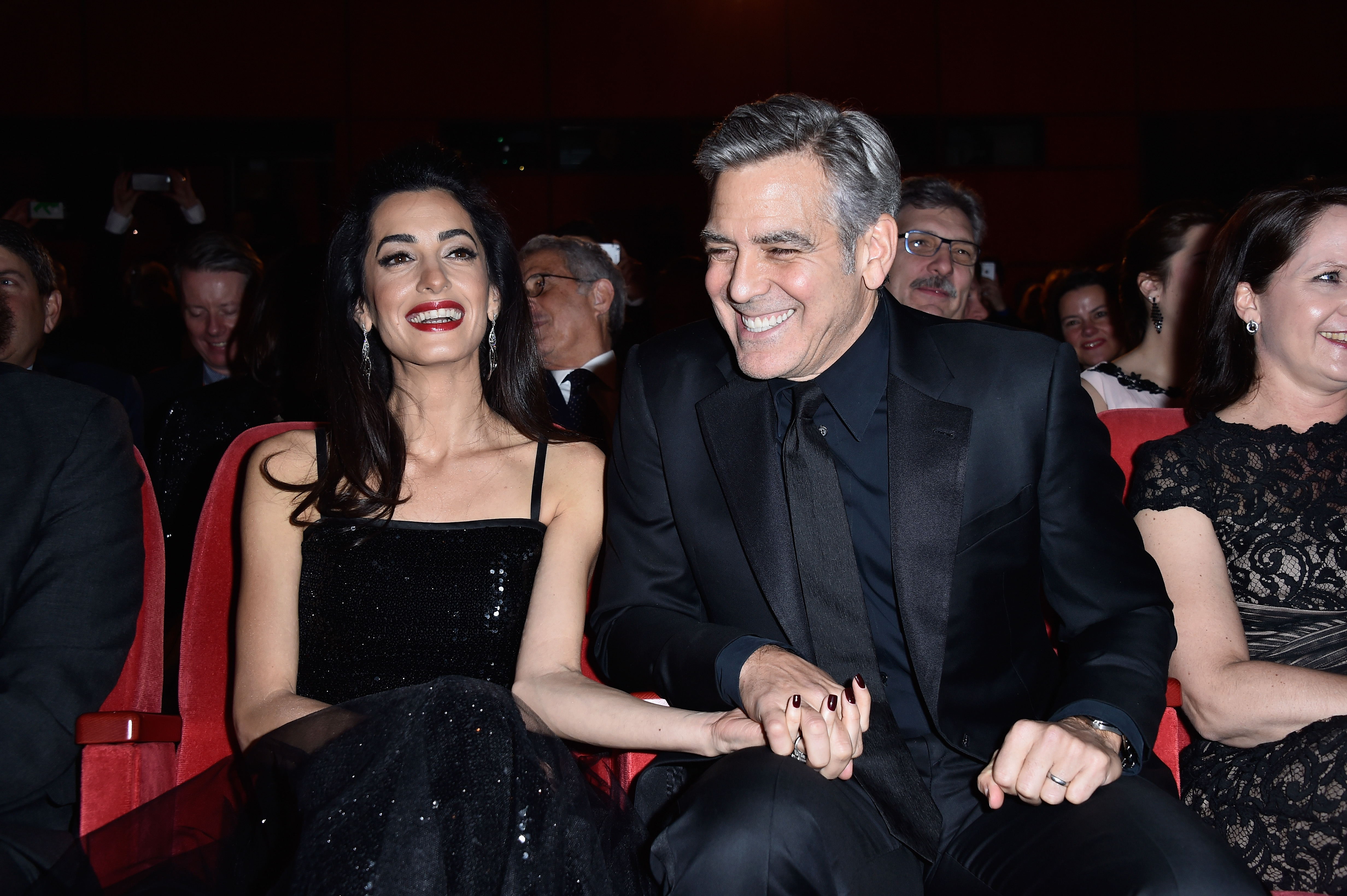 George Clooney and his wife Amal attend the premier of Hail, Caesar! during the Berlin International Film Festival on Feb. 11, 2016, in Berlin