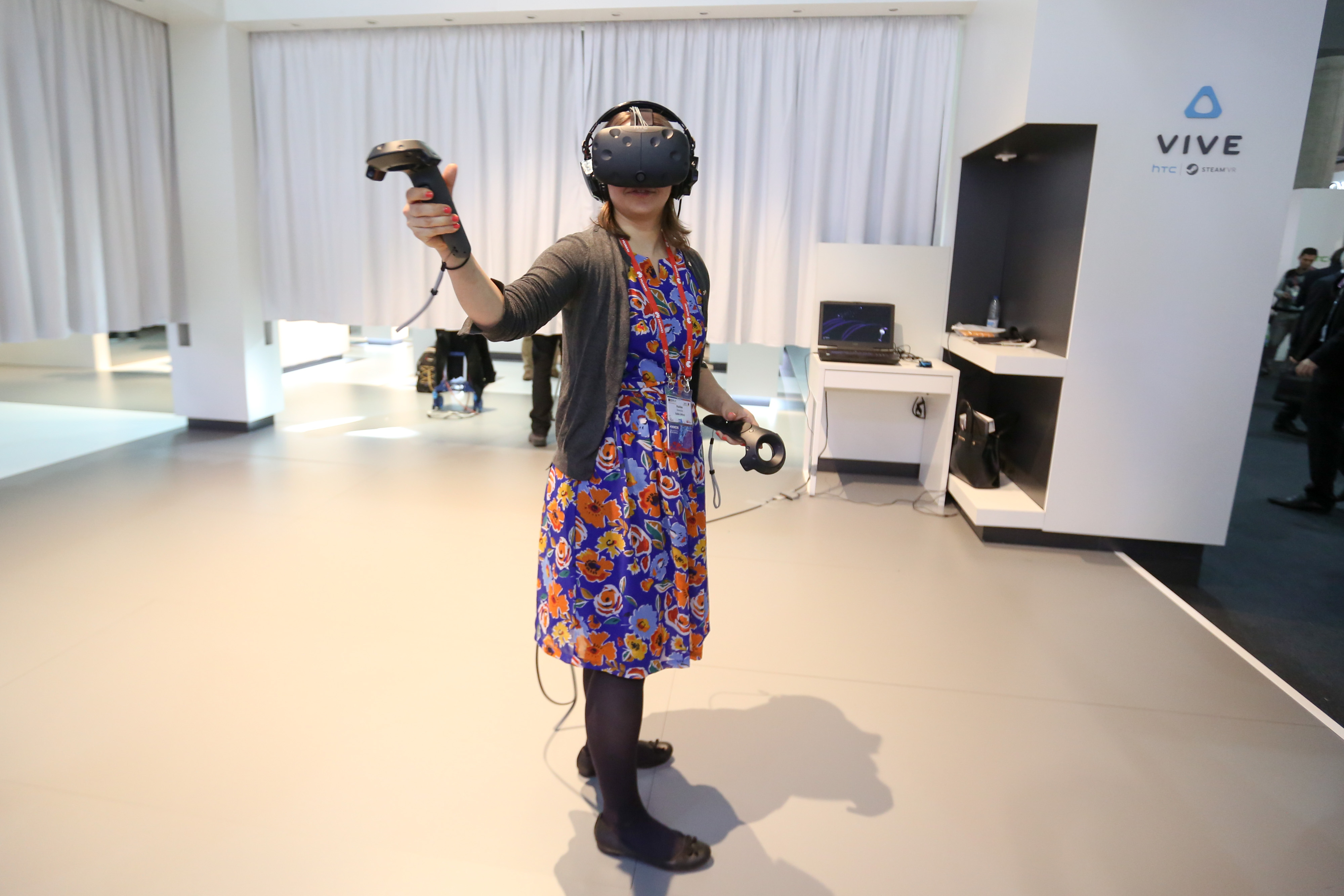 An attendee tries the Vive virtual reality experience on the HTC Corp. stand at the Mobile World Congress in Barcelona, Spain, on Monday, Feb. 22, 2016.