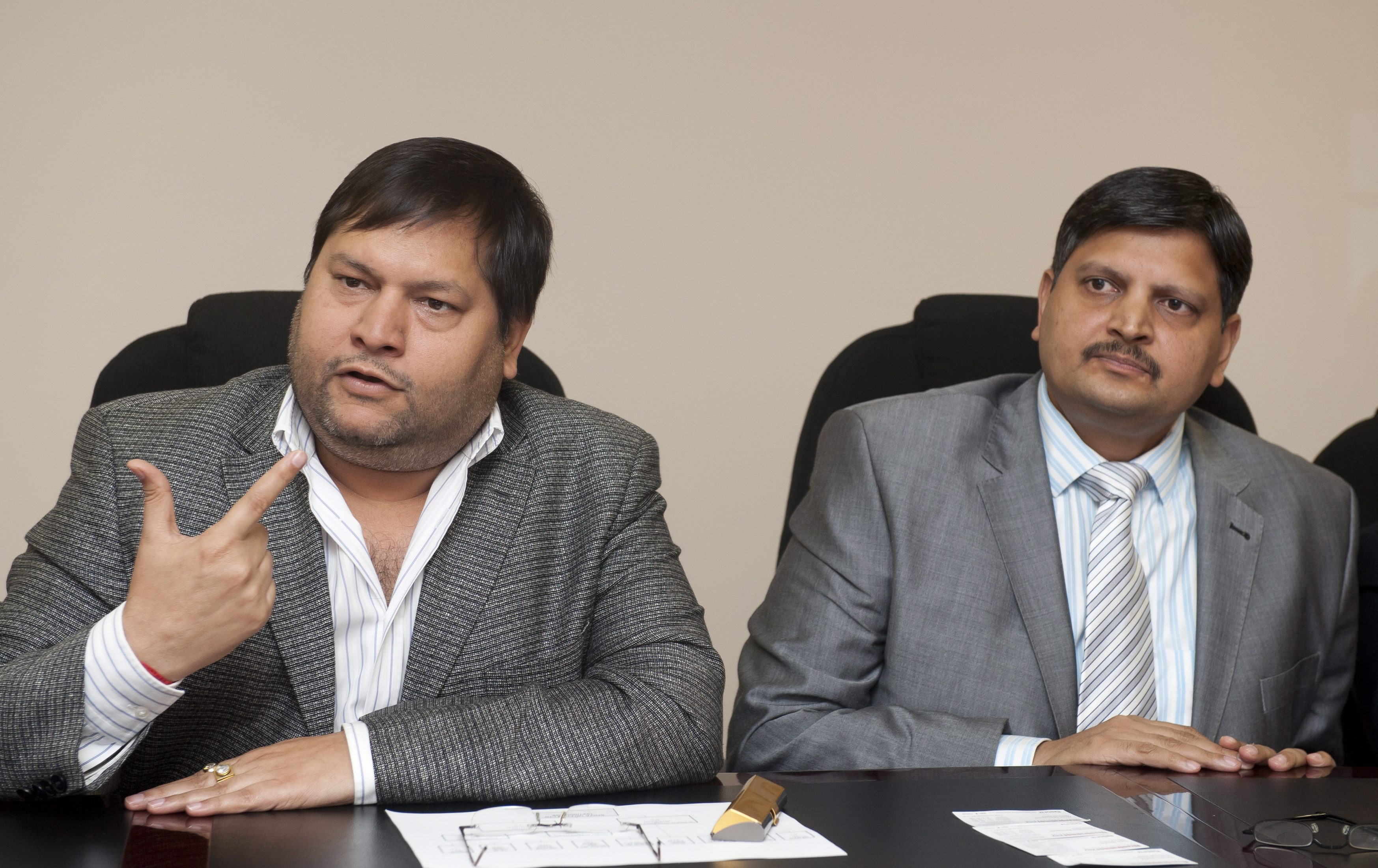 Indian businessmen Ajay Gupta, right, and younger brother Atul Gupta in Johannesburg on March 2, 2011