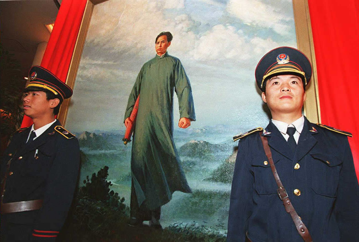 Security guards protect  the painting  Chairman Mao Goes to Anyuan  by Liu Chunhua, which was sold at an auction in Beijing 07 October, 1995 for $728,900 — at the time, the highest price ever offered for an auctioned Chinese oil painting.  The painting, which depicts Mao in his late 20s on a trip to initiate a strike in the coal mining town of Anyuan, pushed the personality cult of Mao to a climax when it was issued during the Cultural Revolution.