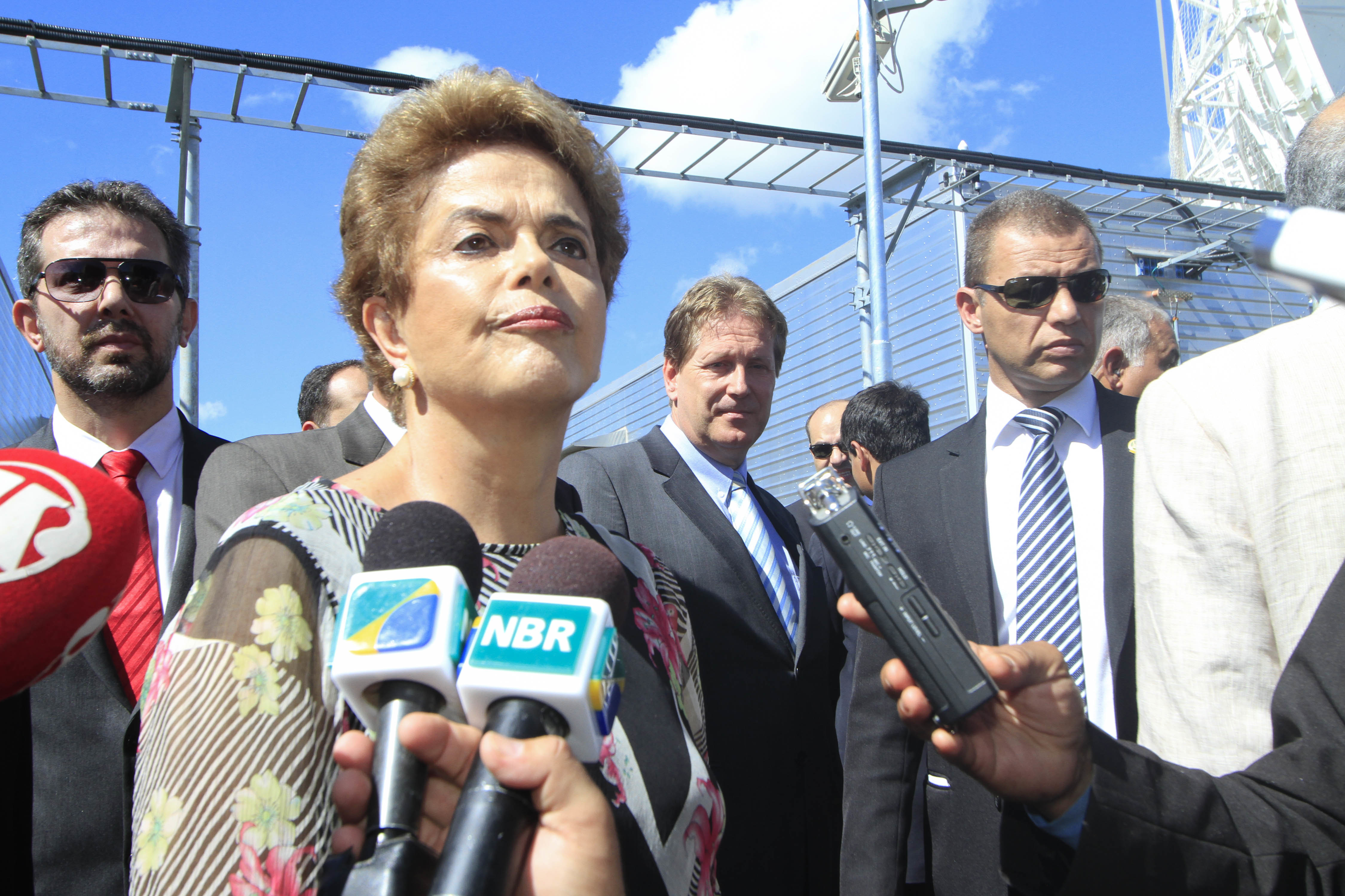 President of Brazil Dilma Rousseff talks with journalists  during a visit to the site of the infrastructure project for the Geostationary Defense and Strategic Communications Satellite of the Air Force's Space Operations Center on March 23, 2016 in Lago Sul, Brazil.