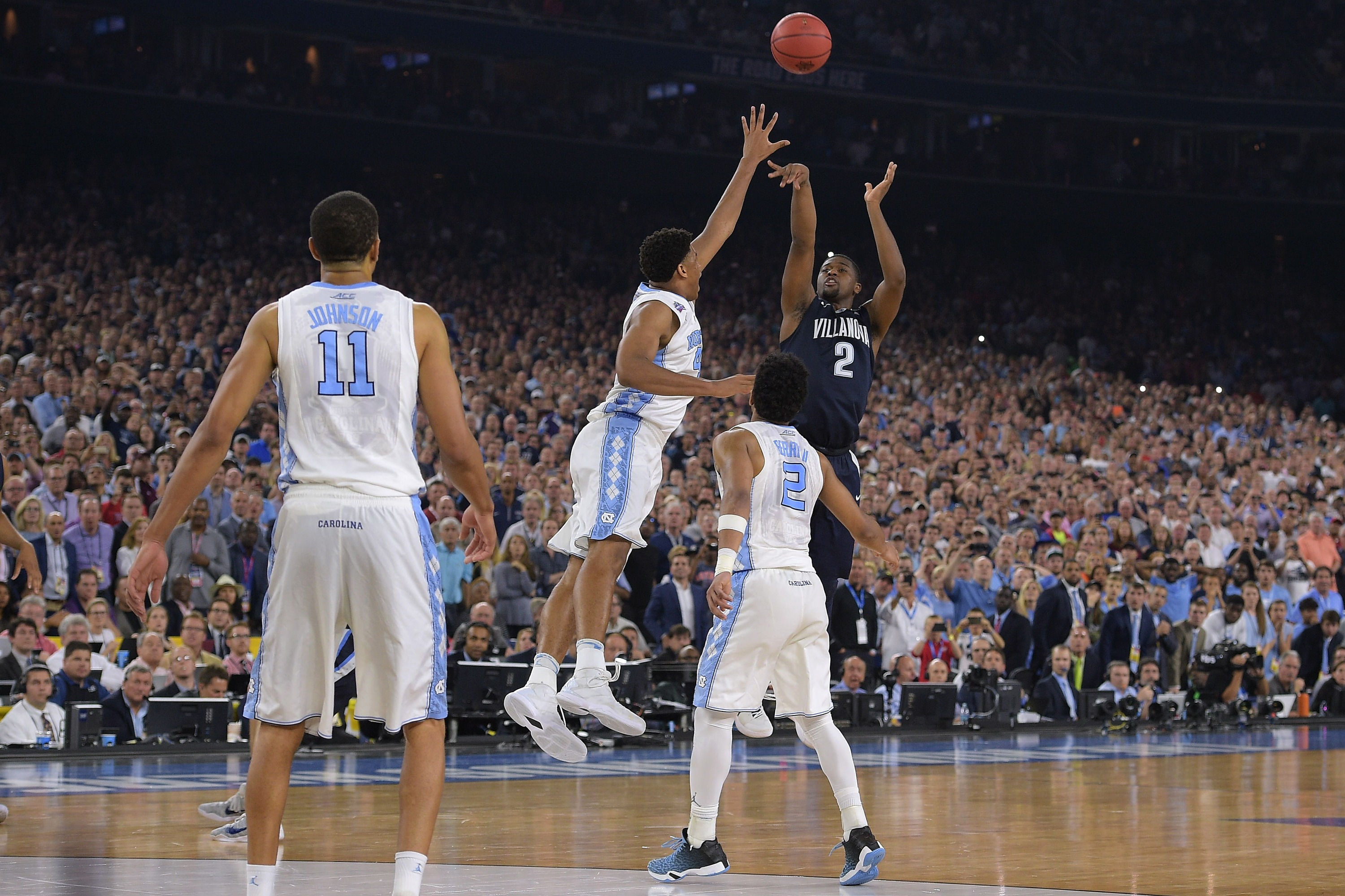 Kris Jenkins #2 of the Villanova Wildcats puts up the game-winning three-point shot as time expires against the North Carolina Tar Heels during the 2016 NCAA Men's Final Four Championship at NRG Stadium on April 04, 2016 in Houston, Texas.