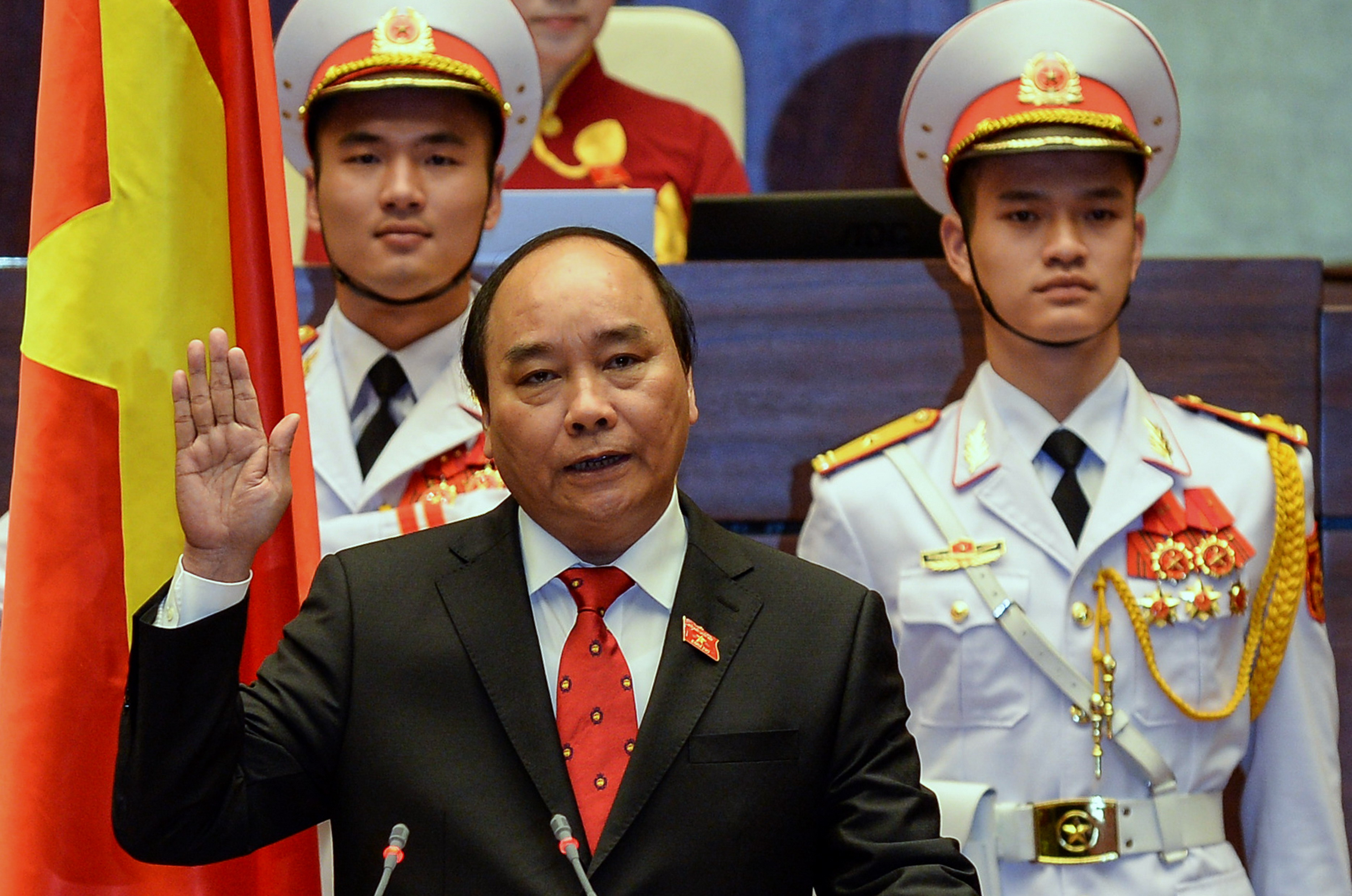 Newly elected Vietnamese Prime Minister Nguyen Xuan Phuc, 61, is sworn in during a ceremony at parliament house in Hanoi on April 7, 2016