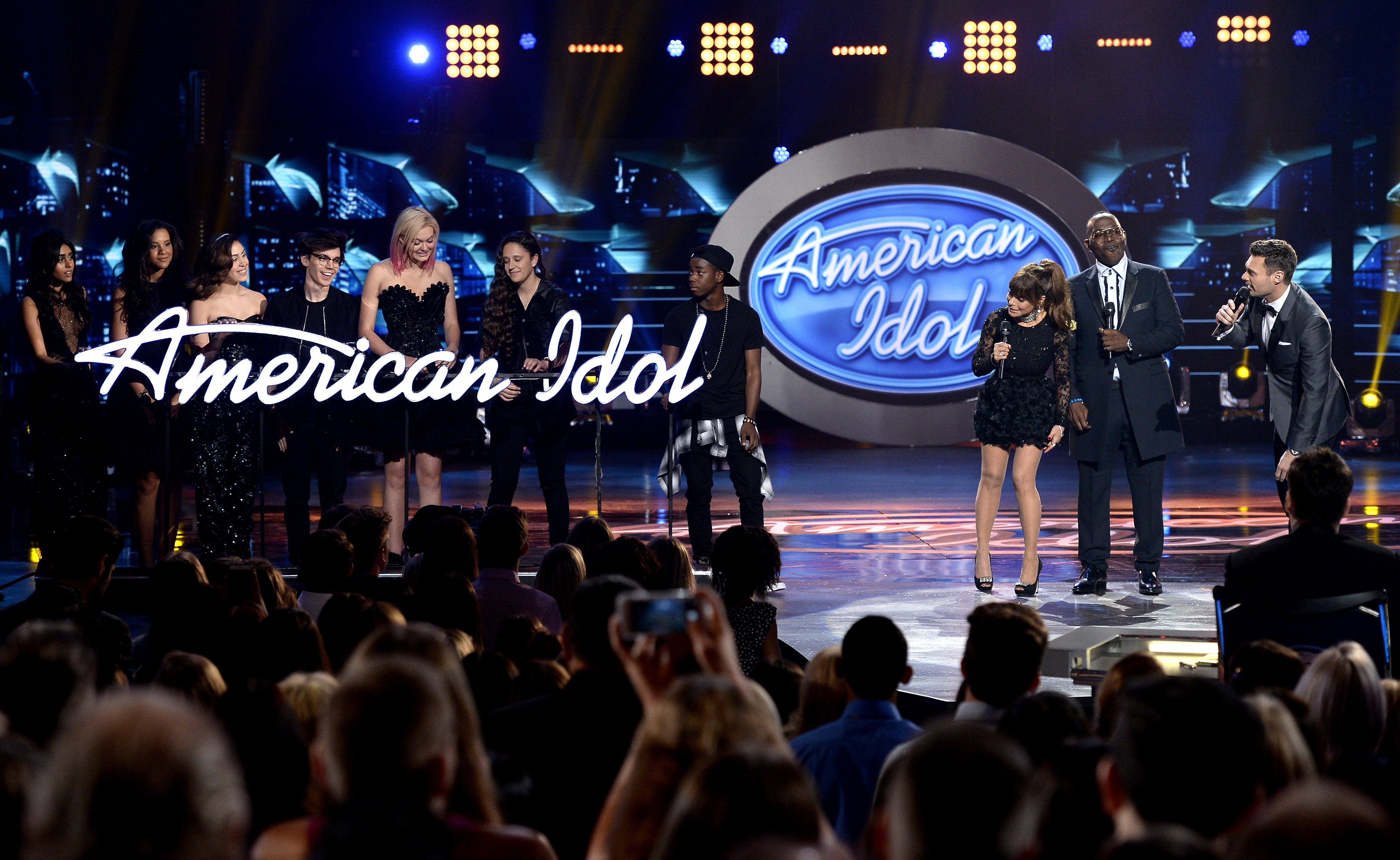 Season 1 judges Paula Abdul and Randy Jackson and the cast of Season 15 present host Ryan Seacrest with a gift onstage during FOX's  American Idol  Finale For The Farewell Season at Dolby Theatre on April 7, 2016 in Hollywood, California.