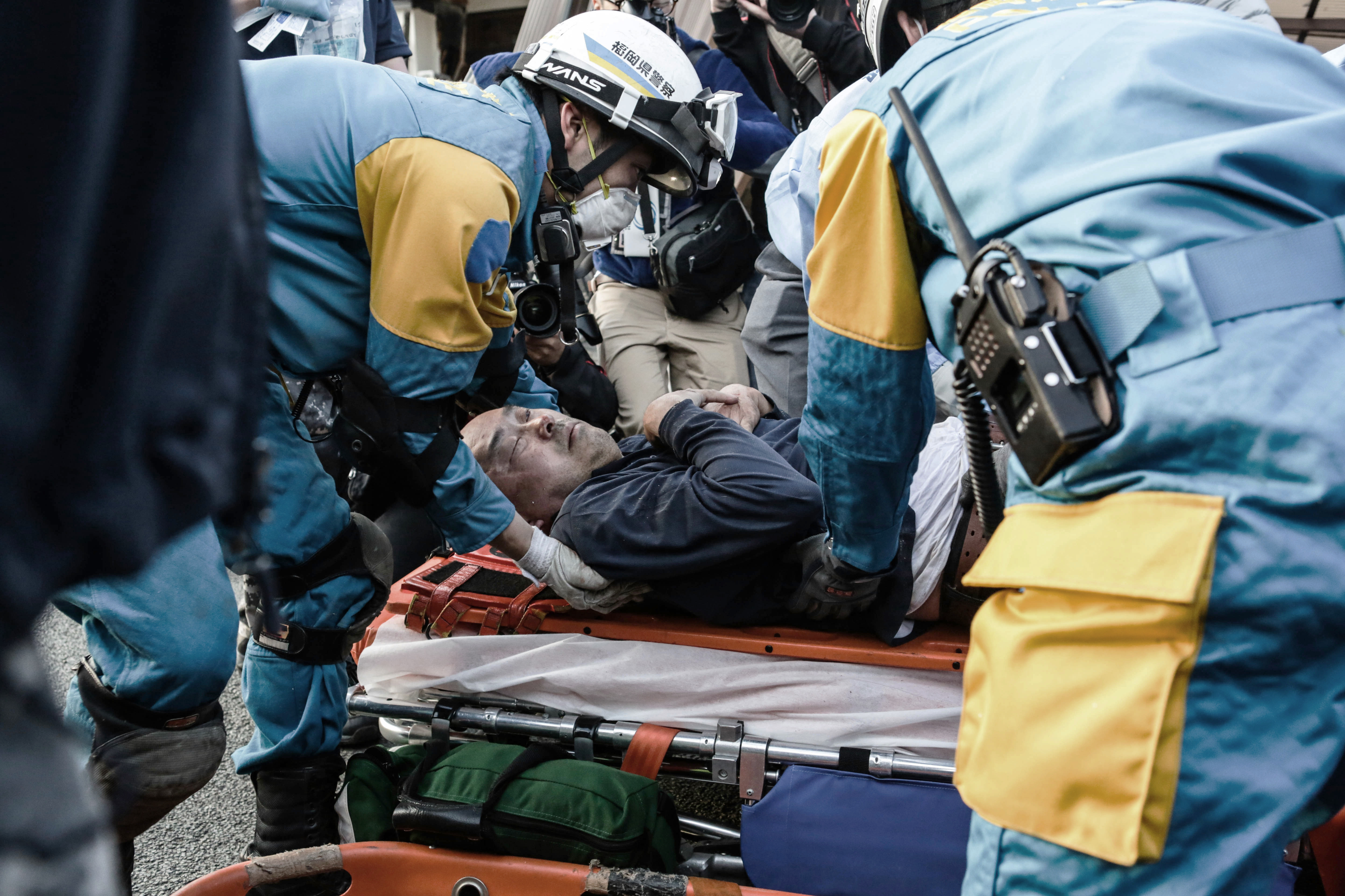 Rescue team saved a man from his house buried alive in Kumamoto, on April 16, 2016.