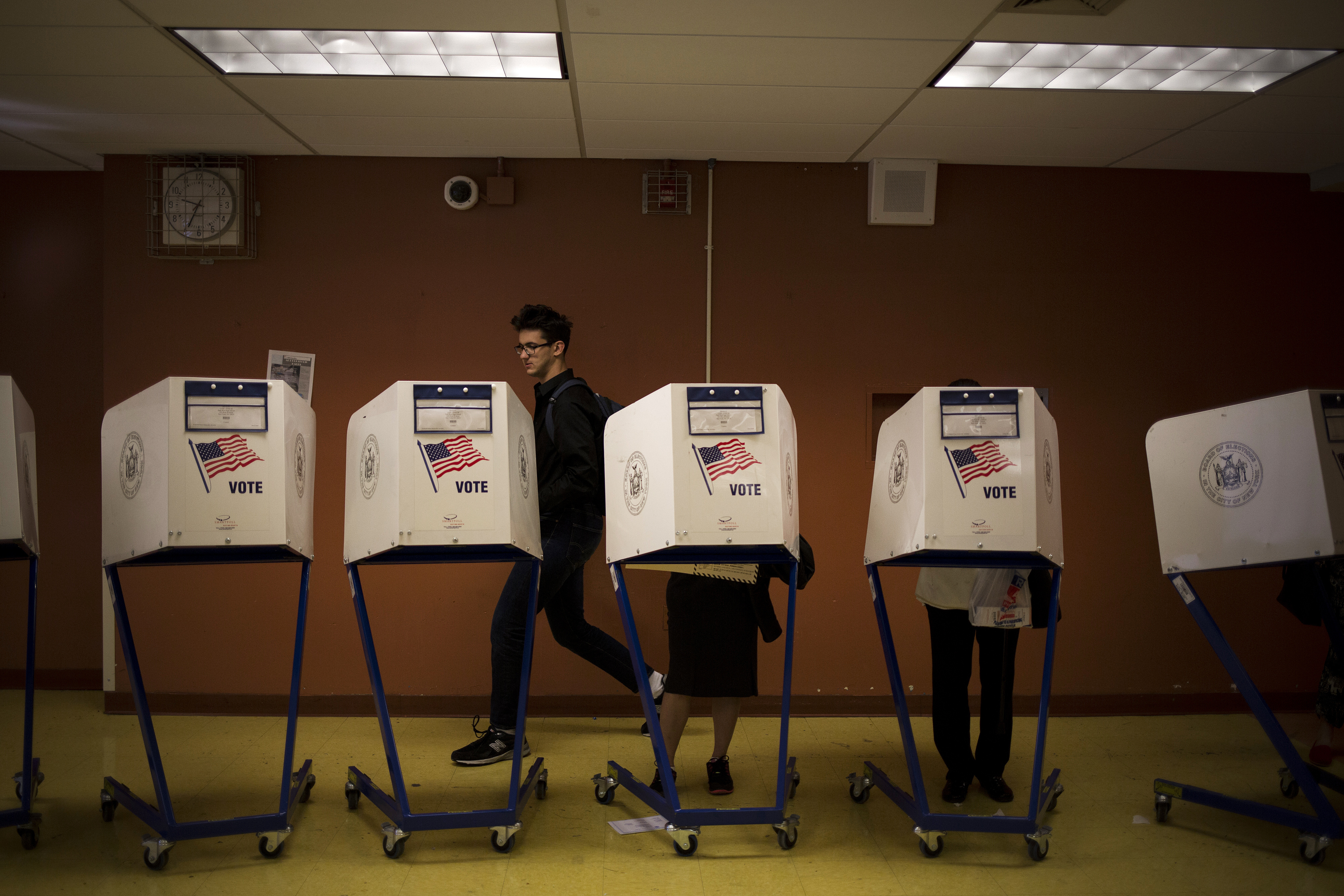 Residents cast ballots during the presidential primary vote at a polling location in New York on April 19, 2016.