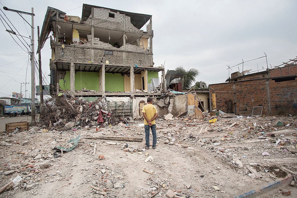 PEDERNALES, ECUADOR - APRIL 21:  A man observes the aftermaths of an earthquake struck Ecuador on April 21, 2016 in Pedernales, Ecuador. At least 400 people were killed after a 7.8-magnitude quake and the government's food supply is not reaching everyone. (Photo by Edu Leon/LatinContent/Getty Images)