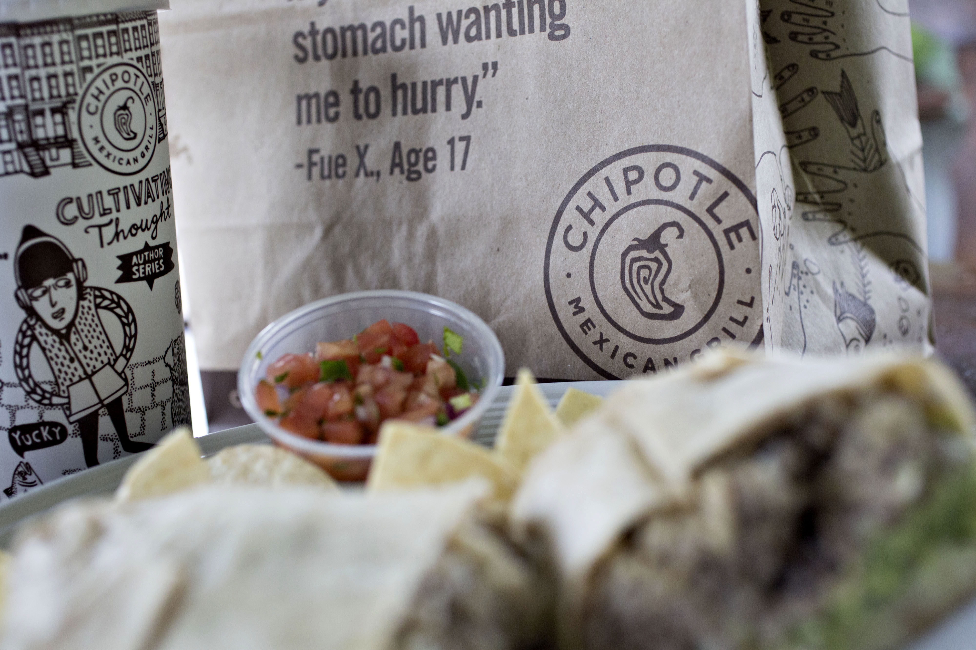 Chipotle Mexican Grill Inc. take-out food is arranged for a photograph in Tiskilwa, Illinois, U.S., on Friday, April 22, 2016. Chipotle Mexican Grill Inc. is expected to release earnings figures on April 26. Bloomberg—Bloomberg via Getty Images