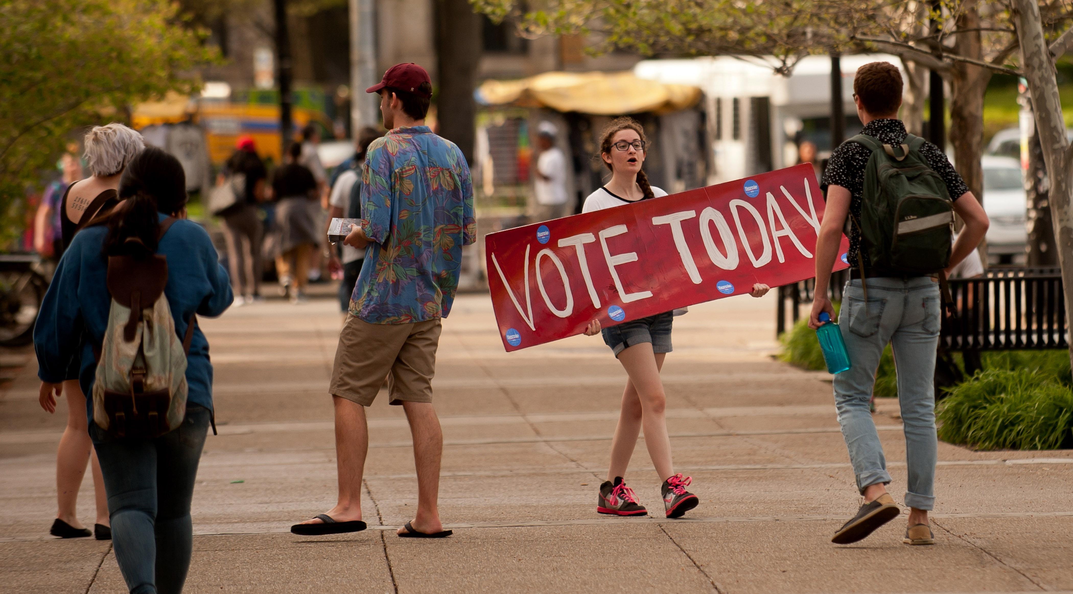 Bernie Sanders supporter Maria DelGrande implores passersby to vote in the Pennsylvania primary election on April 26, 2016 in Pittsburgh, Pennsylvania.