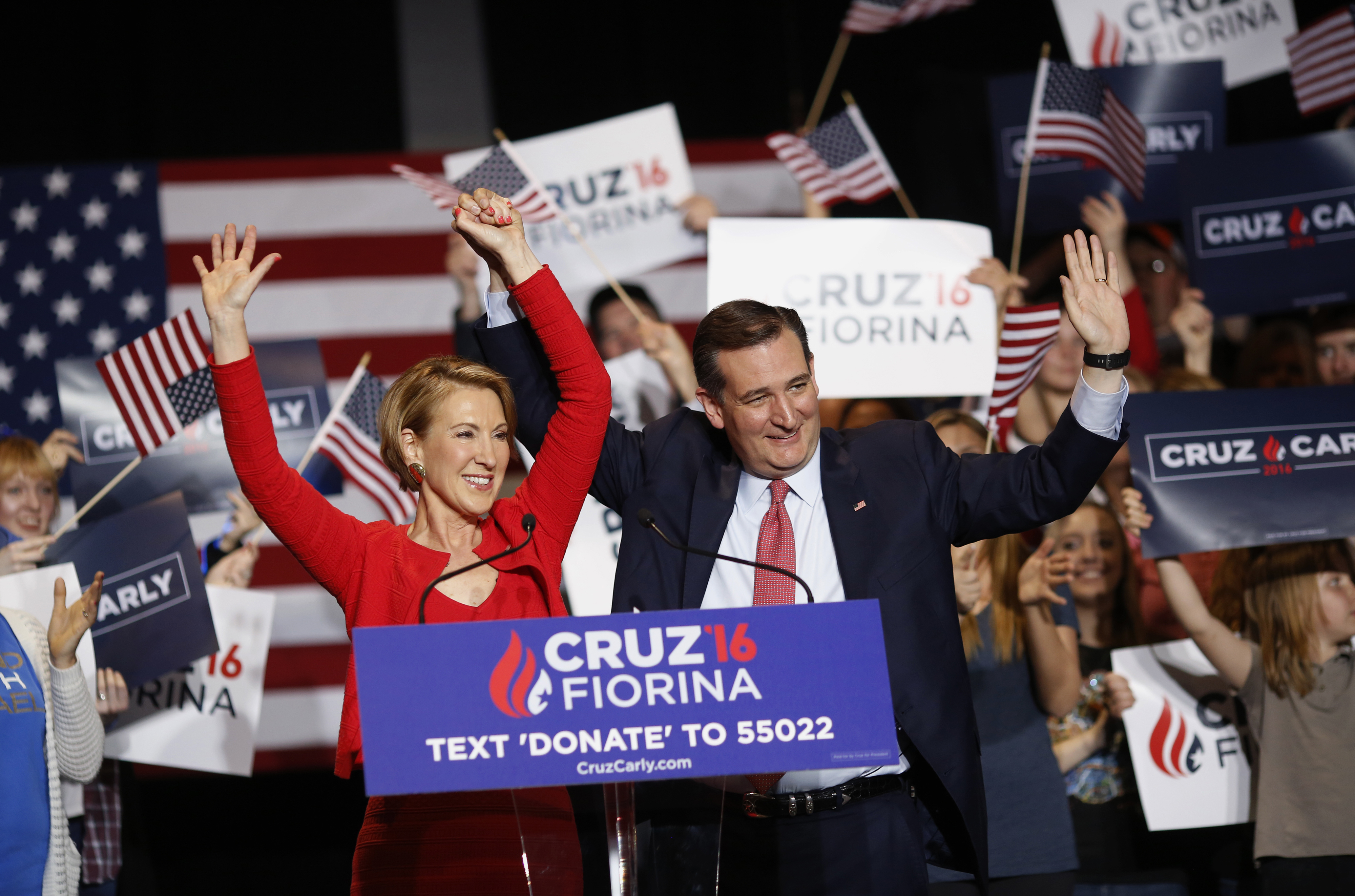 Carly Fiorina, former chairman and chief executive officer of Hewlett-Packard Co., left, and Senator Ted Cruz, a Republican from Texas and 2016 presidential candidate, waves to attendees during a campaign rally in Indianapolis on April 27, 2016.