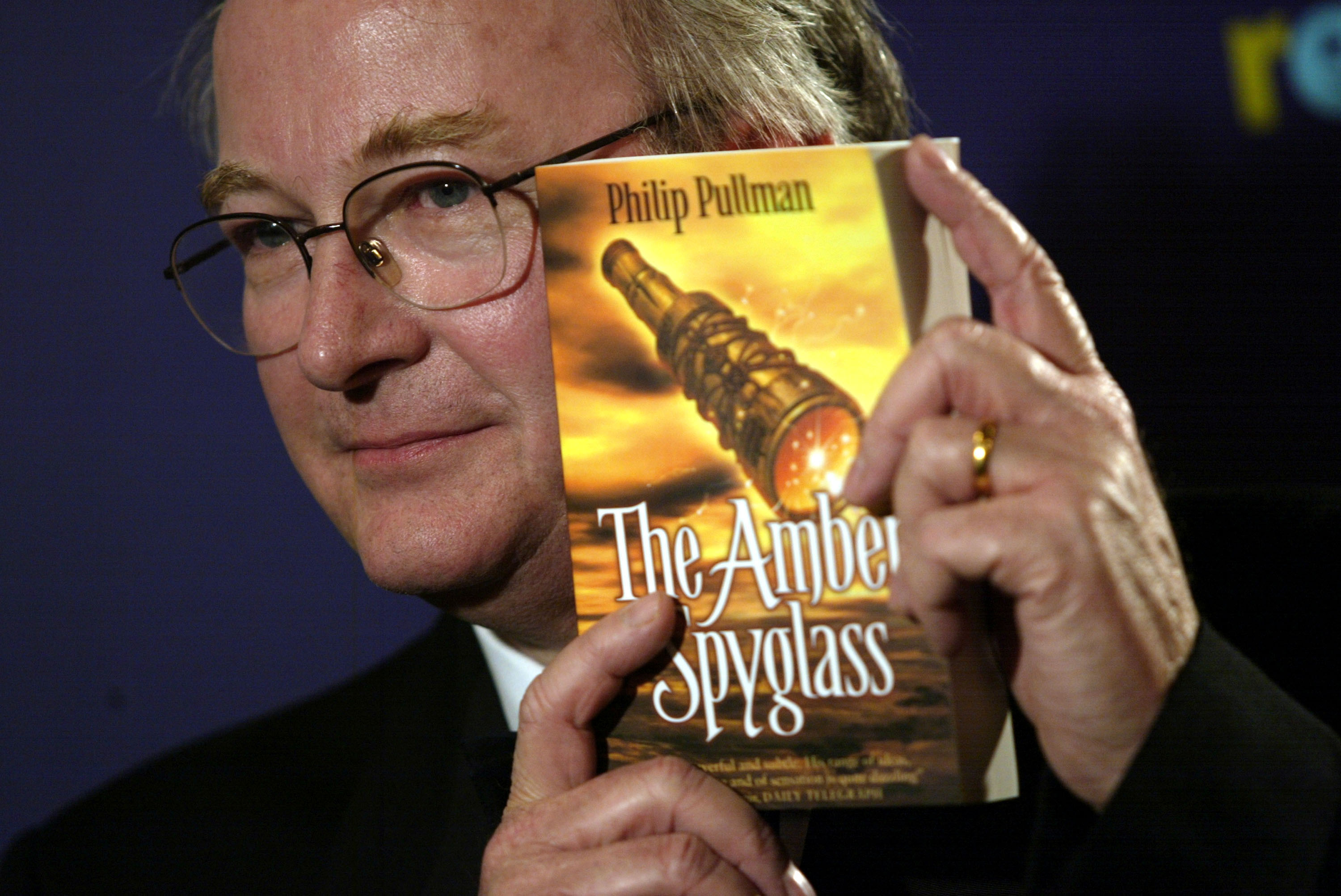 Author Philip Pullman holds up his book, ''The Amber Spyglass'', after winning the Whitbread Book of the Year Award January 22, 2002 in London.