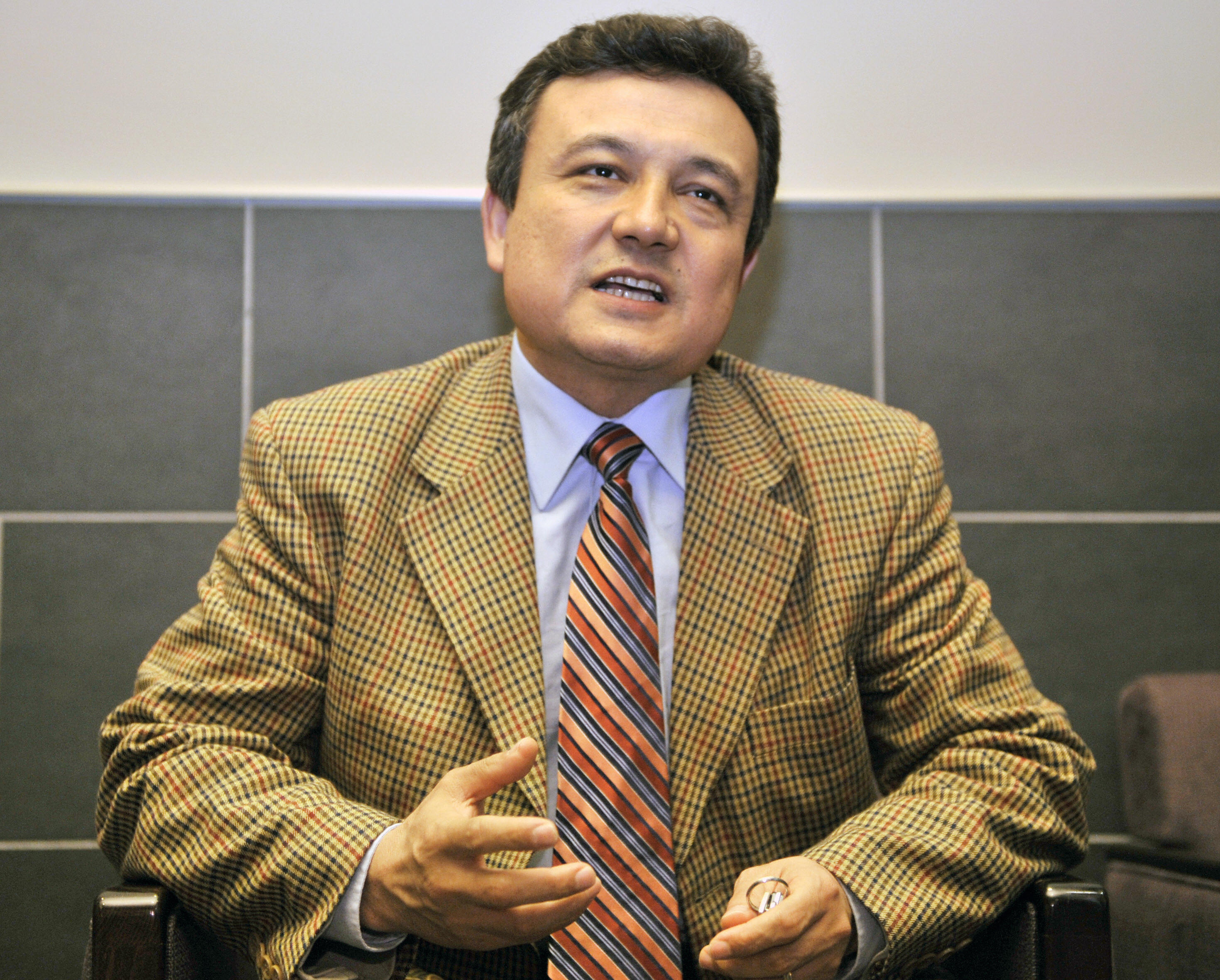 Dolkun Isa, secretary general of the World Uyghur Congress, speaks to a reporter during an interview in Tokyo on May 2, 2008