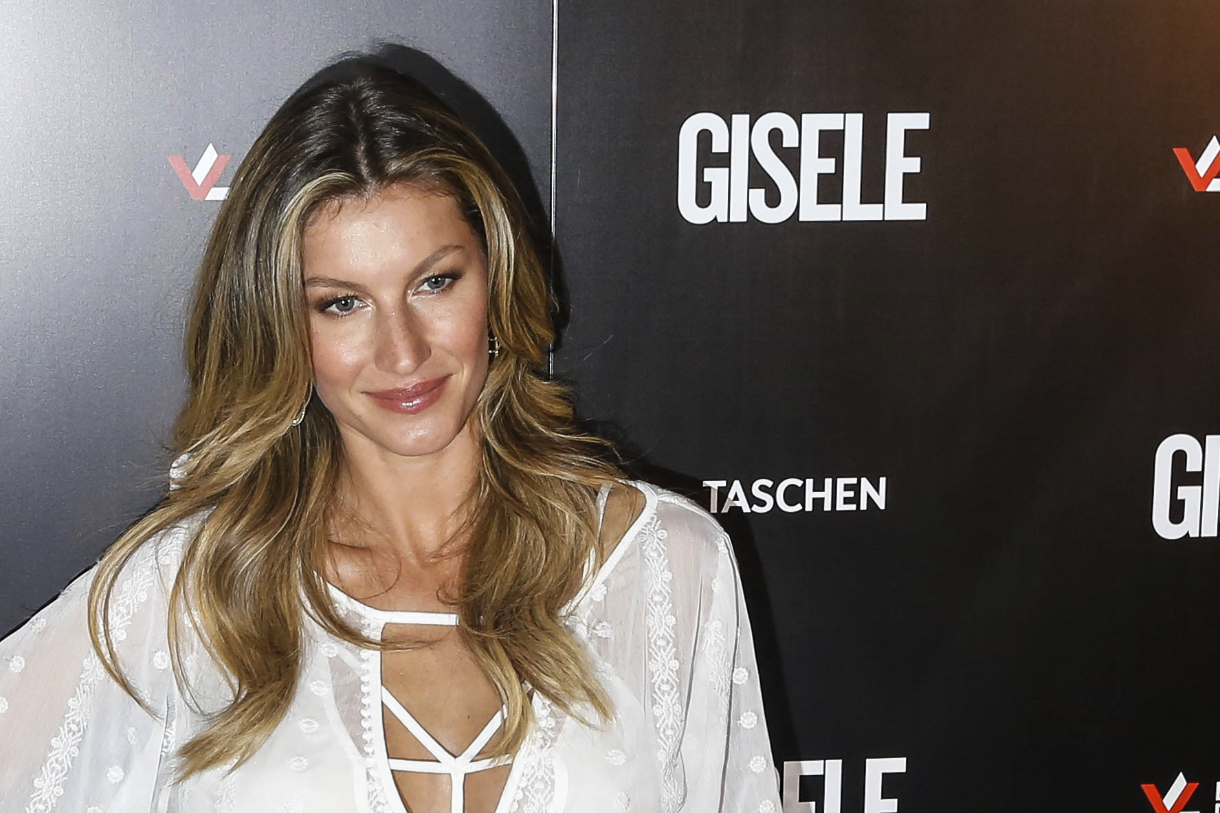 Brazilian model Gisele Bundchen poses for pictures during her book signing on November 06, 2015 in Sao Paulo, Brazil.