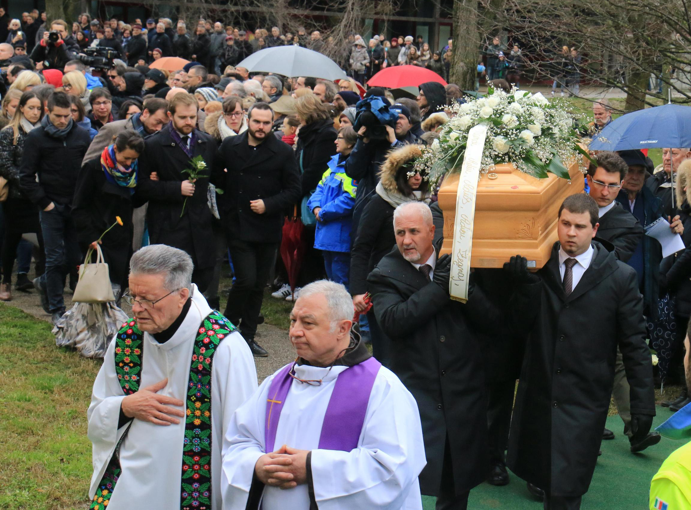 Mourners follow the casket holding the body of Italian graduate student Giulio Regeni, who was found dead in Egypt, during his funeral in Fiumicello, northern Italy, Feb. 12, 2016.