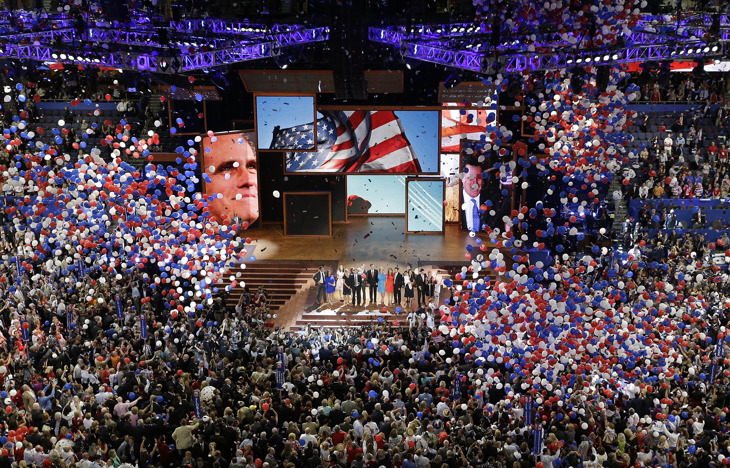 In this Aug. 30, 2012, file photo, Republican presidential nominee Mitt Romney and vice presidential nominee Rep. Paul Ryan are joined on the stage by their families at the end of the Republican National Convention in Tampa, Fla.