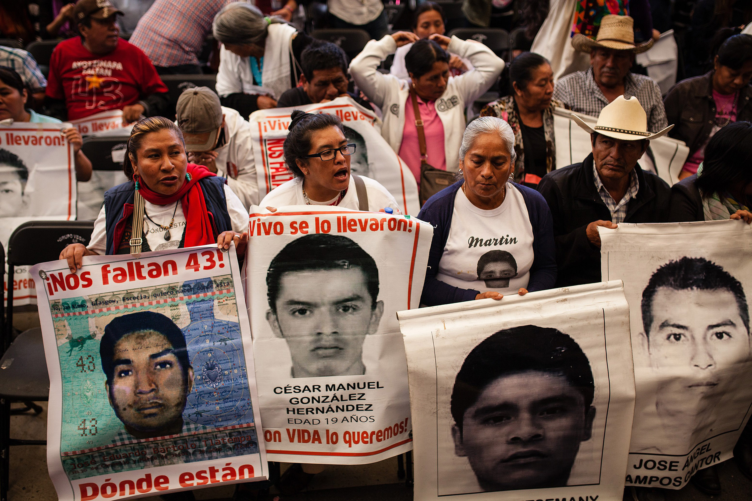 Relatives of the 43 missing students in Ayotzinapa stage a protest during the news conference of the Interdisciplinary Group of Independent Experts to publicize details of the report about the disappearances in Mexico City, Mexico, April 24, 2016.